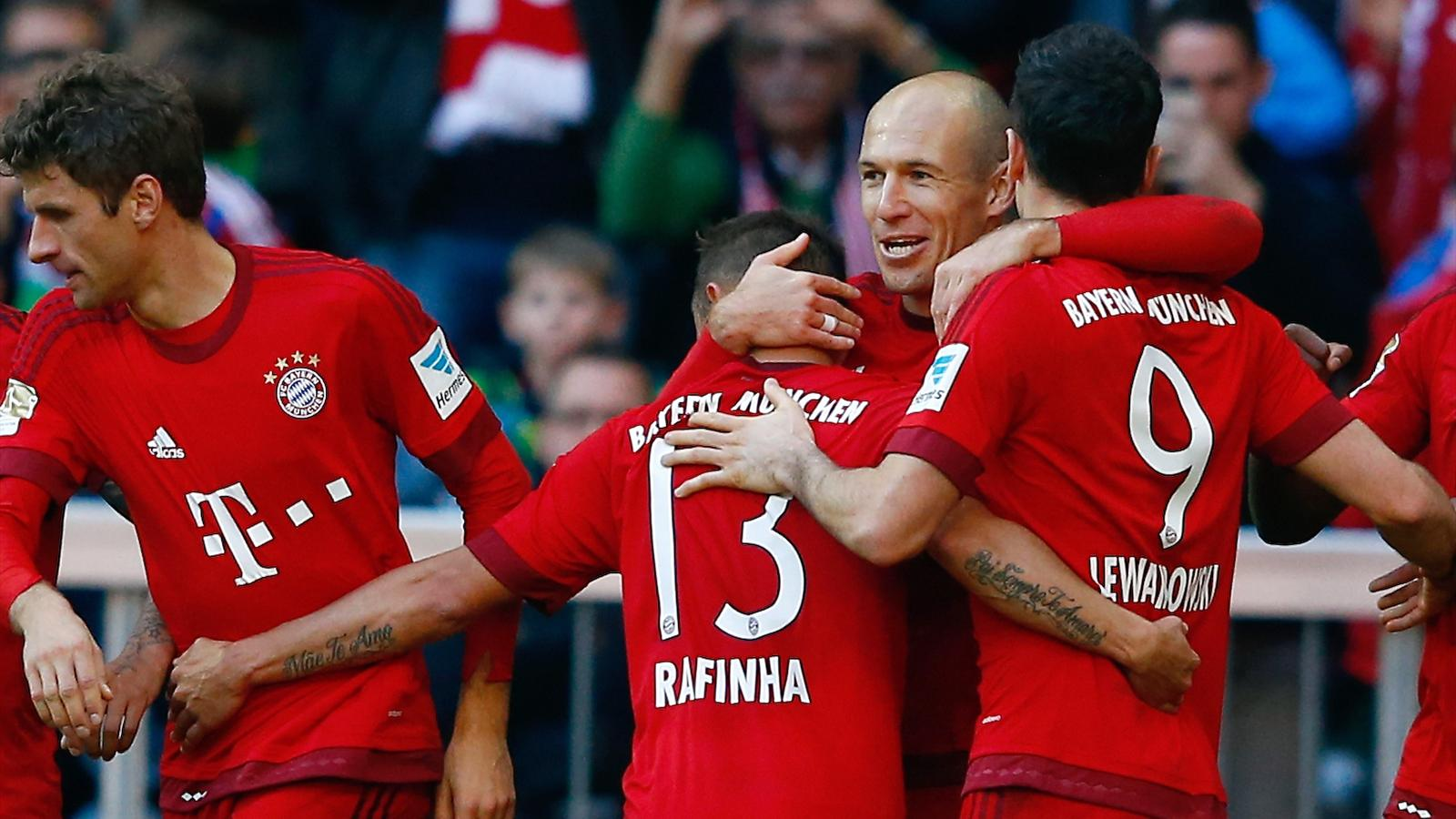 Bayern Munich's Arjen Robben (2nd R) celebrates with team mates after he scored against Cologne during their Bundesliga clash