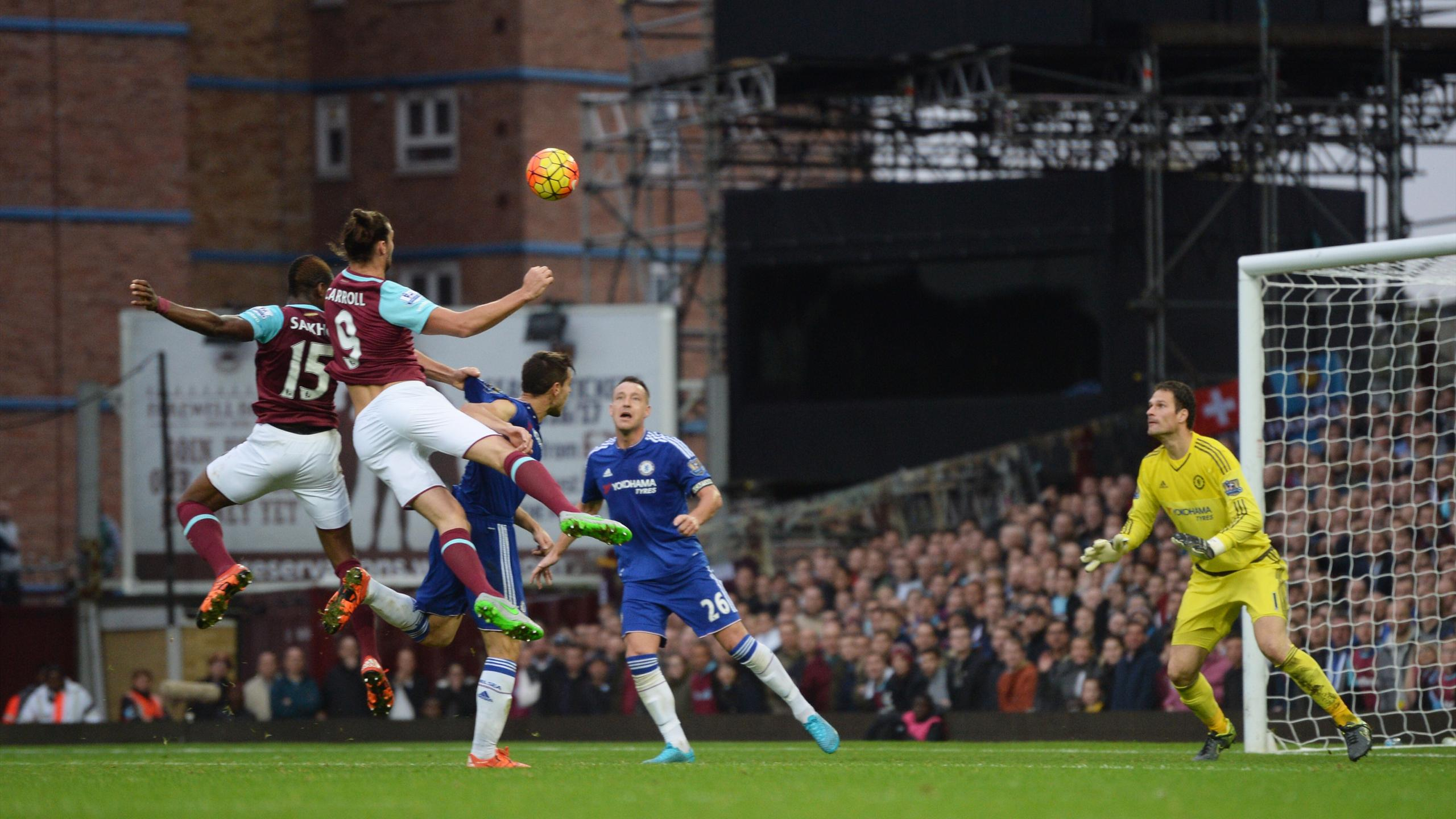 Andy Carroll heads the winning goal for West Ham against Chelsea