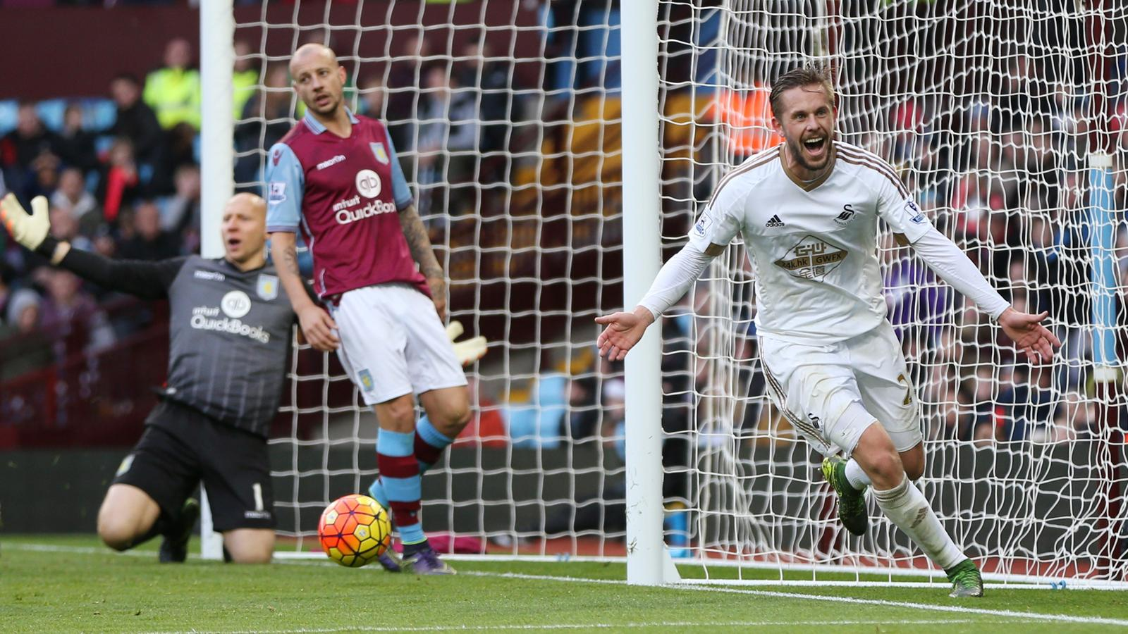 Gylfi Sigurdsson celebrates scoring for Swansea against Aston Villa