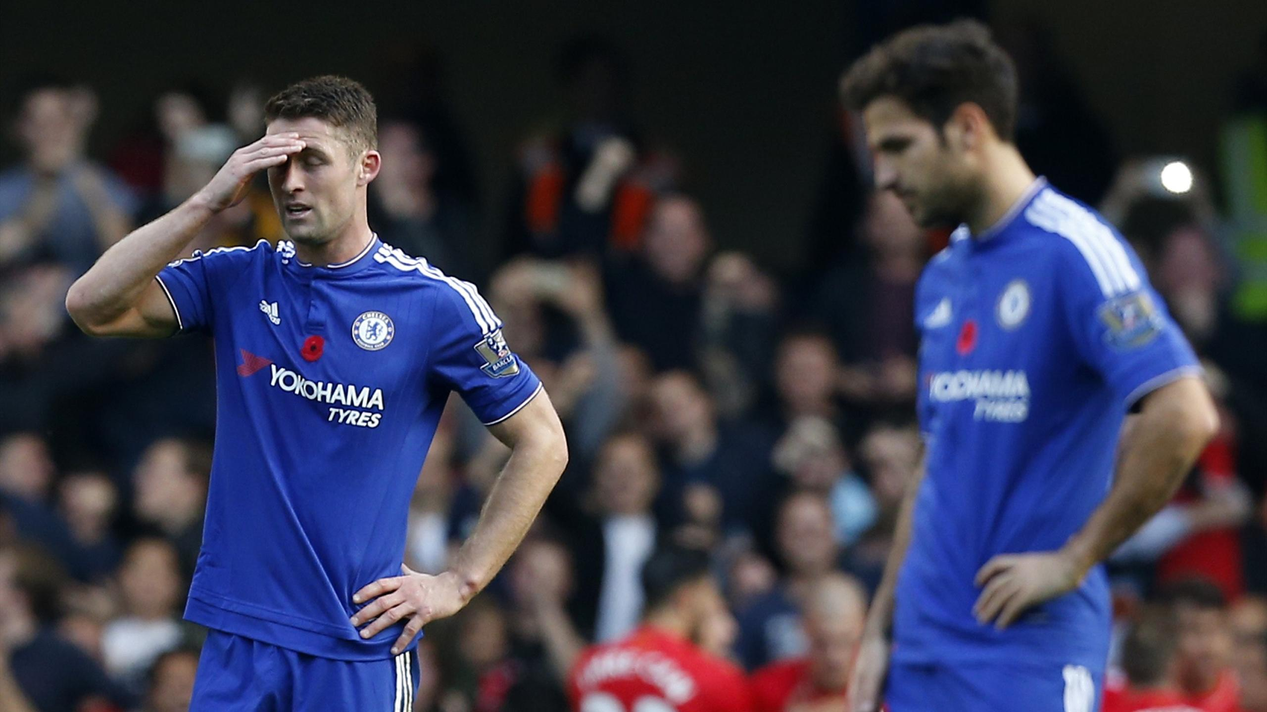 Chelsea's English defender Gary Cahill (L) and Chelsea's Spanish midfielder Cesc Fabregas