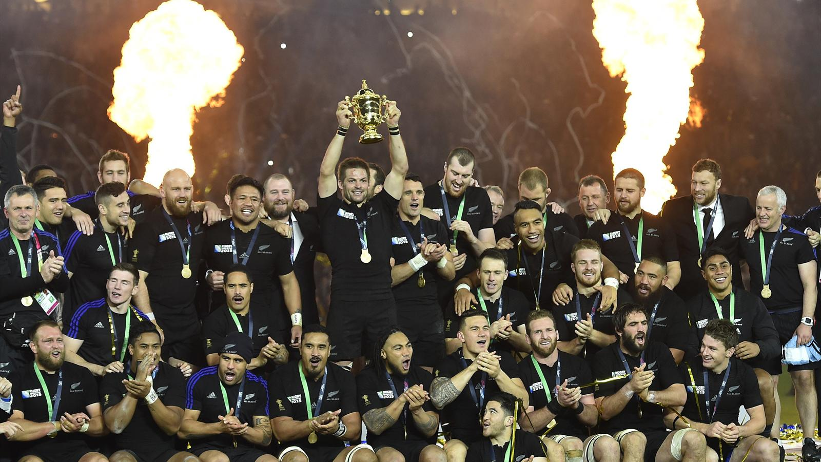 Captain Richie McCaw of New Zealand holds up the Webb Ellis Cup after winning the Rugby World Cup Final against Australia at Twickenham