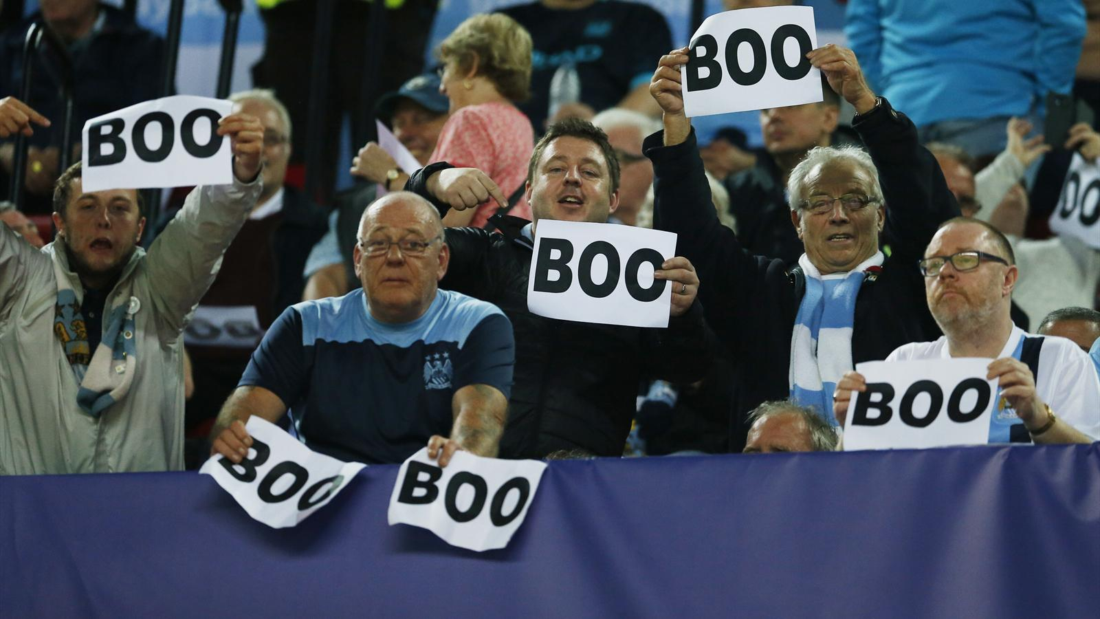 Manchester city fans hold up 39 boo 39 signs before champions - British basketball league table ...