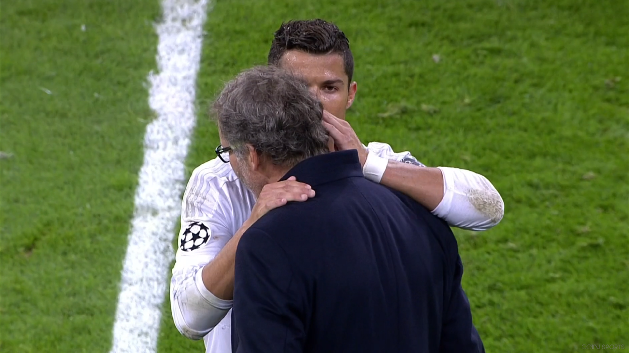 Cristiano Ronaldo told something to Laurent Blanc.