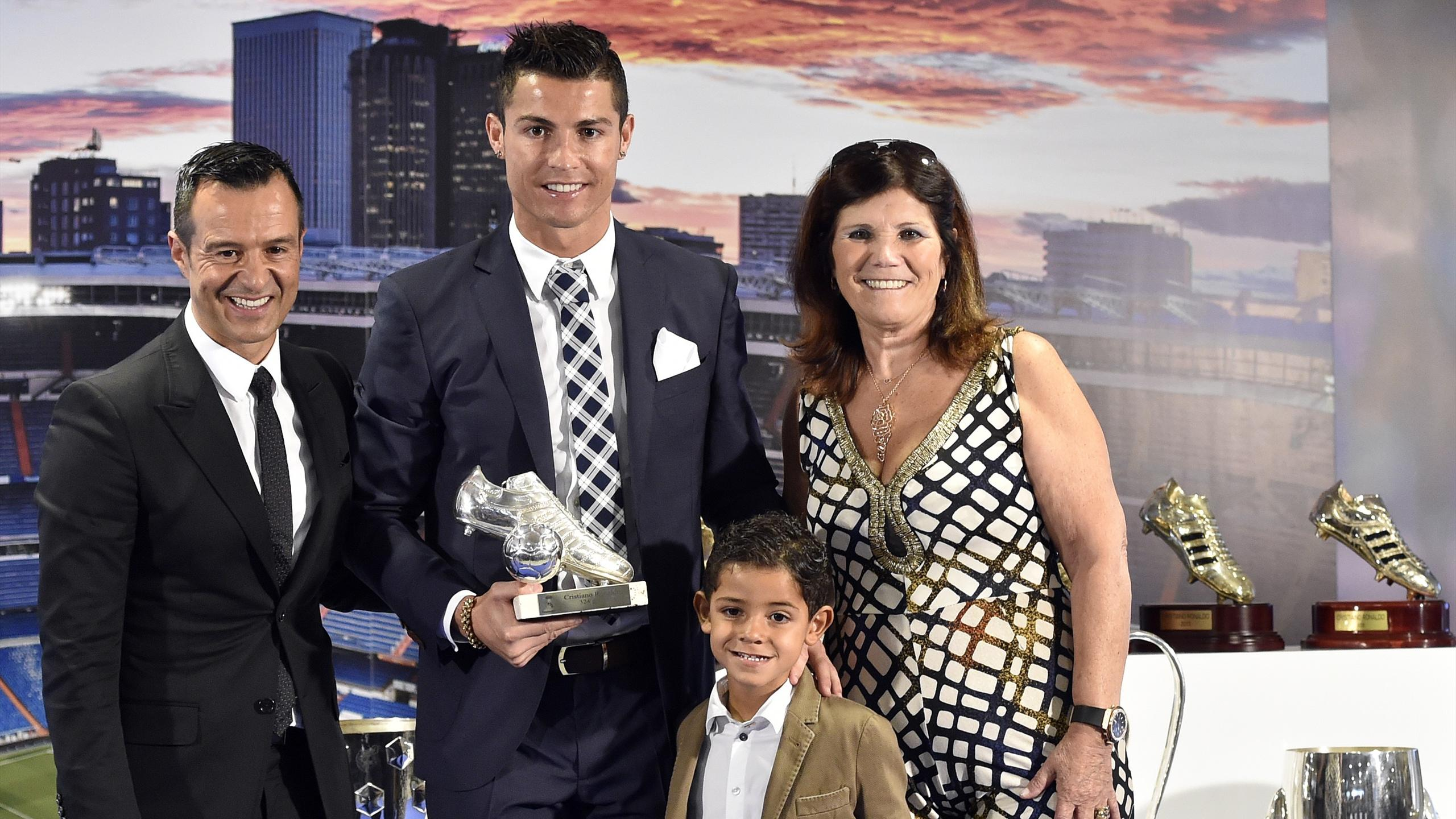 Cristiano Ronaldo with his son, mother and agent Jorge Mendes