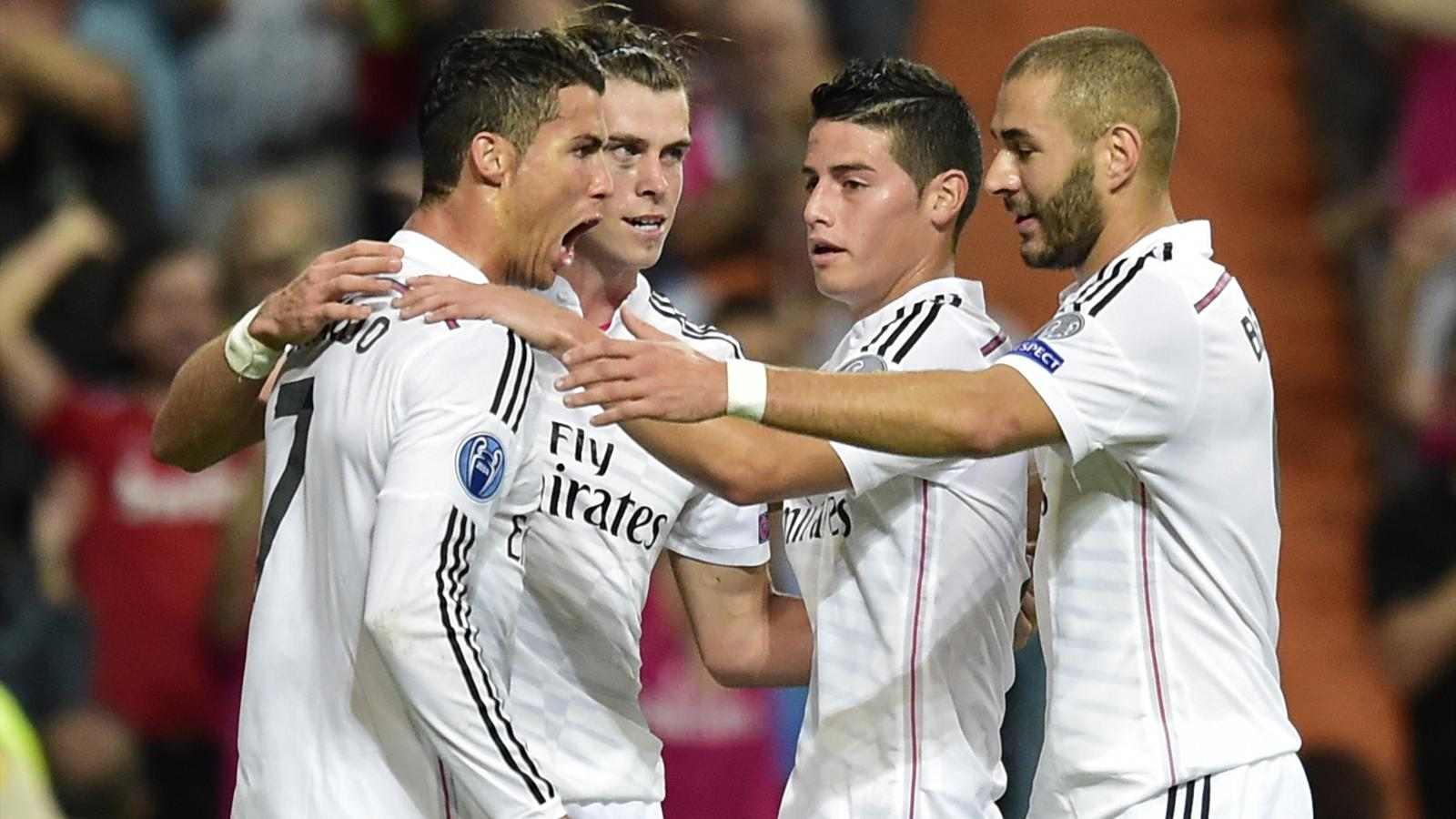 Real Madrid's Portuguese forward Cristiano Ronaldo (L), Real Madrid's Welsh forward Gareth Bale (C), Real Madrid's French forward Karim Benzema (R)and Real Madrid's Colombian midfielder James Rodriguez