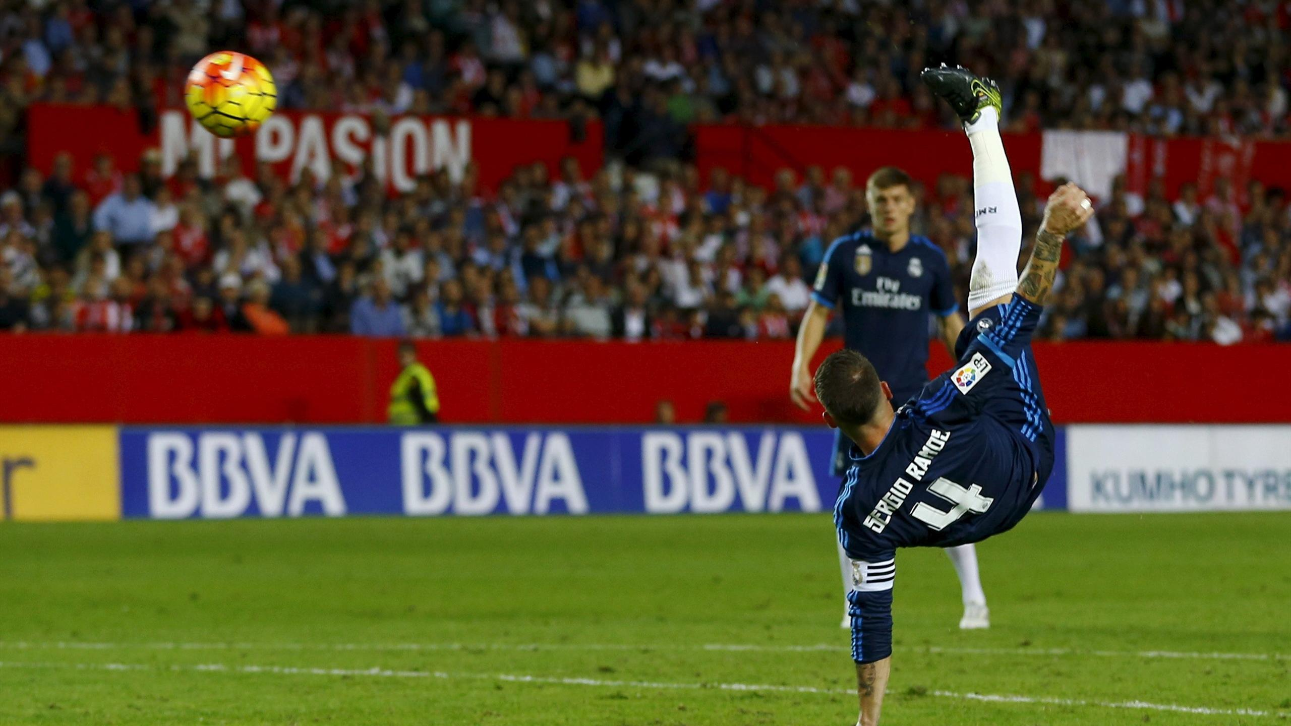 Real Madrid's Sergio Ramos kicks the ball to score against Sevilla