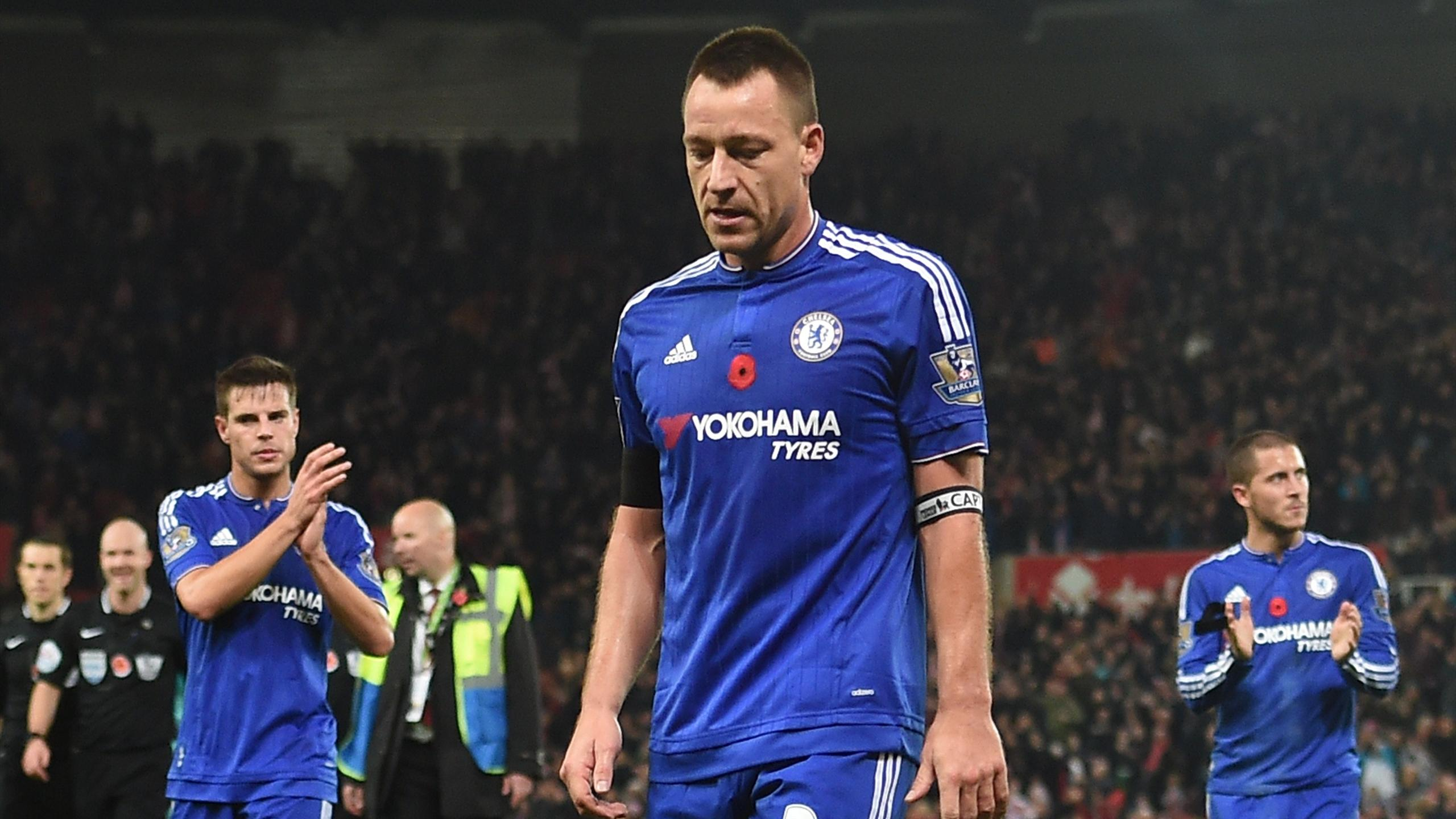 Chelsea's English defender John Terry (C) reacts as he leaves the pitch