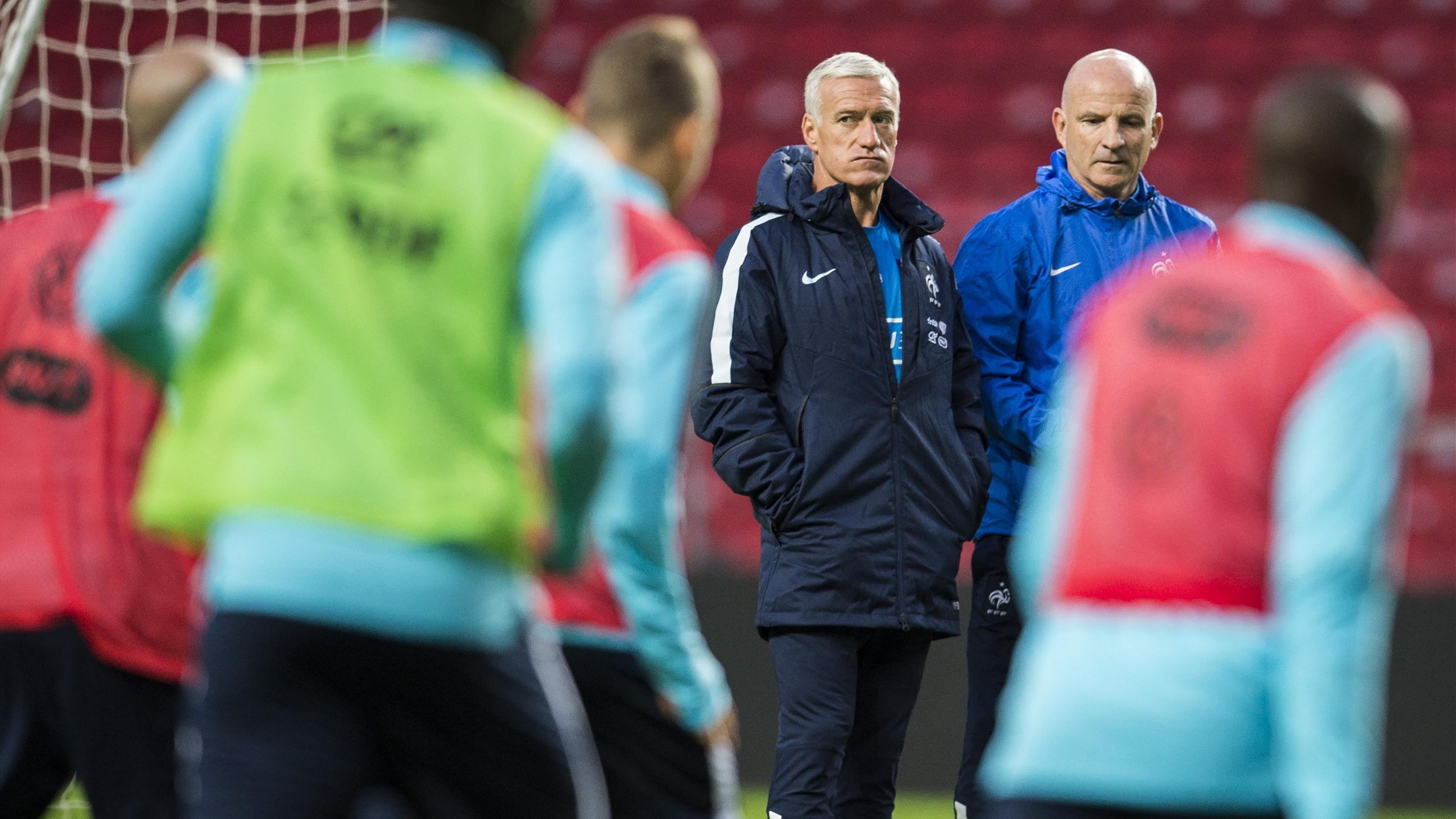 Didier Deschamps watches France in training.
