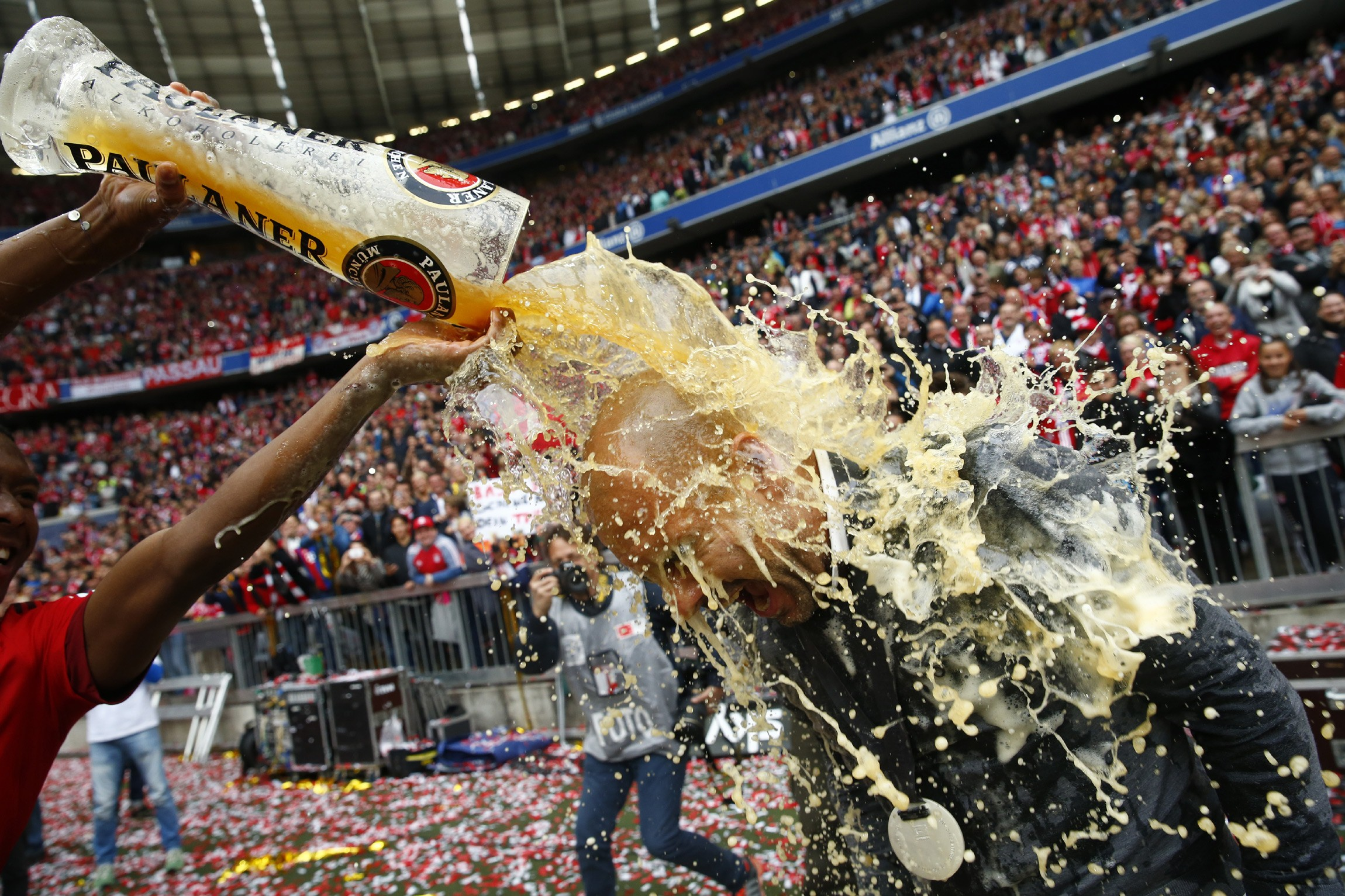 Best sporting pictures of 2015 - Bayern Munich's David Alaba (L) pours beer over coach Pep Guardiola after their final Bundesliga match of the season against FSV Mainz 05 in Munich, May 23, 2015