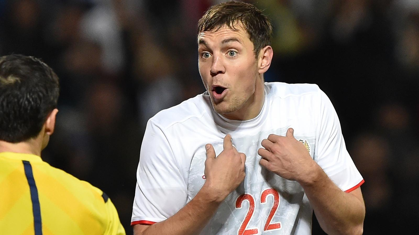 Russia's forward Artem Dzyuba argues with a referee during the friendly football match between Russia and Portugal in Krasnodar on November 14, 2015