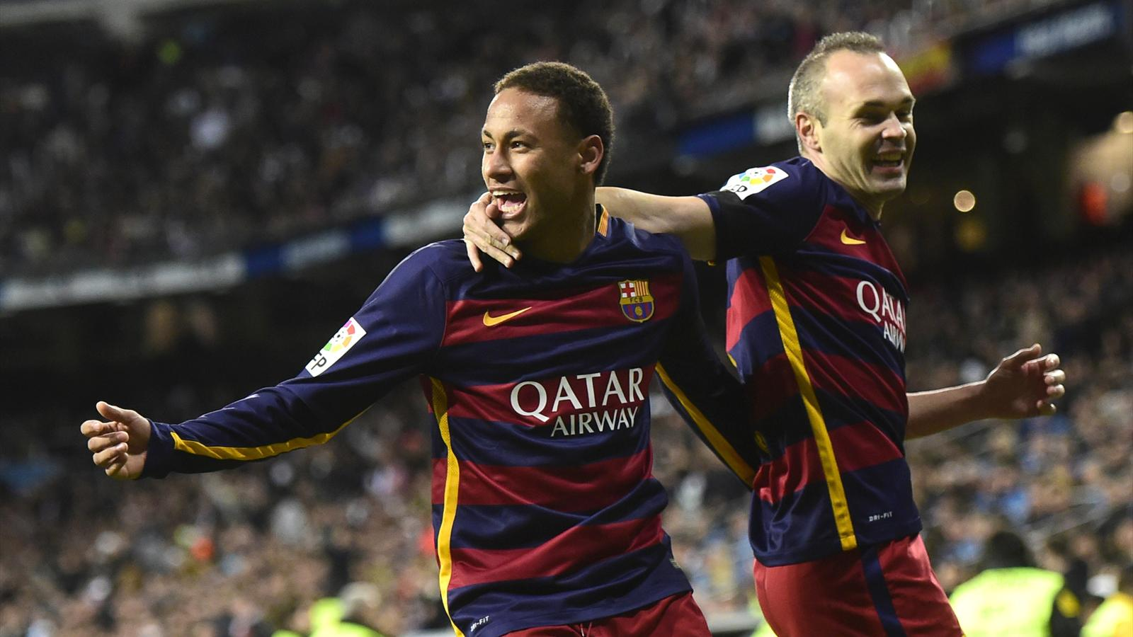 Neymar and Andres Iniesta celebrate a Barcelona goal against Real Madrid