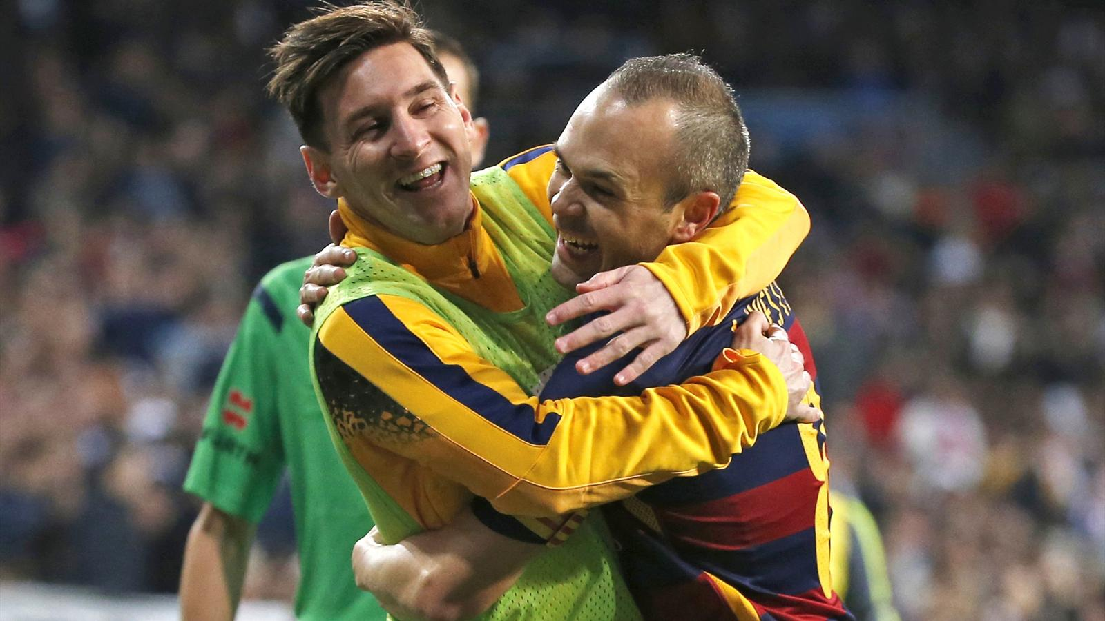 Barcelona's Lionel Messi and Andres Iniesta celebrate a goal against Real Madrid