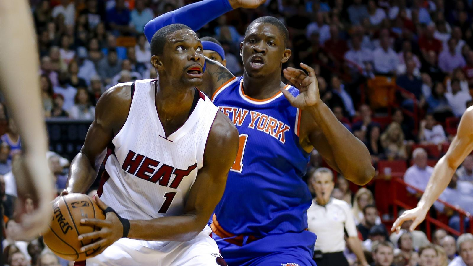Miami's Chris Bosh is fouled by New York Knicks forward Kevin Seraphin
