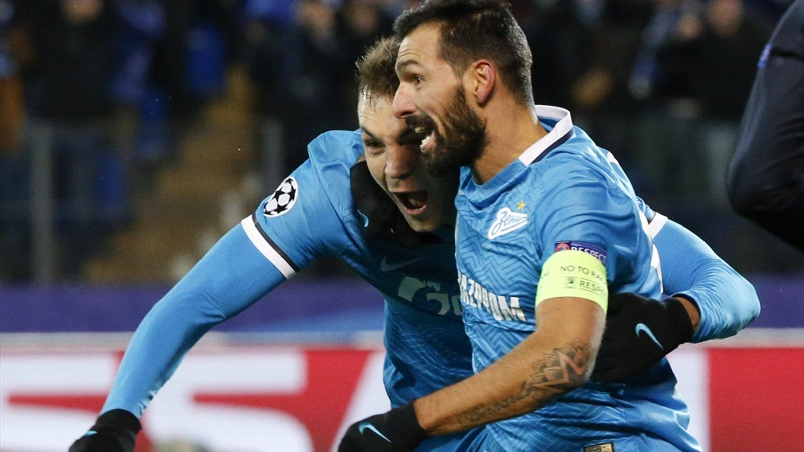 Zenit St. Peterburg's Artem Dzyuba celebrates with his team mate Danny after scoring the second goal