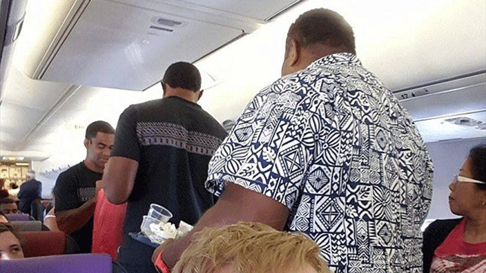 Fiji's rugby players help serve food and drinks on a flight (Facebook)