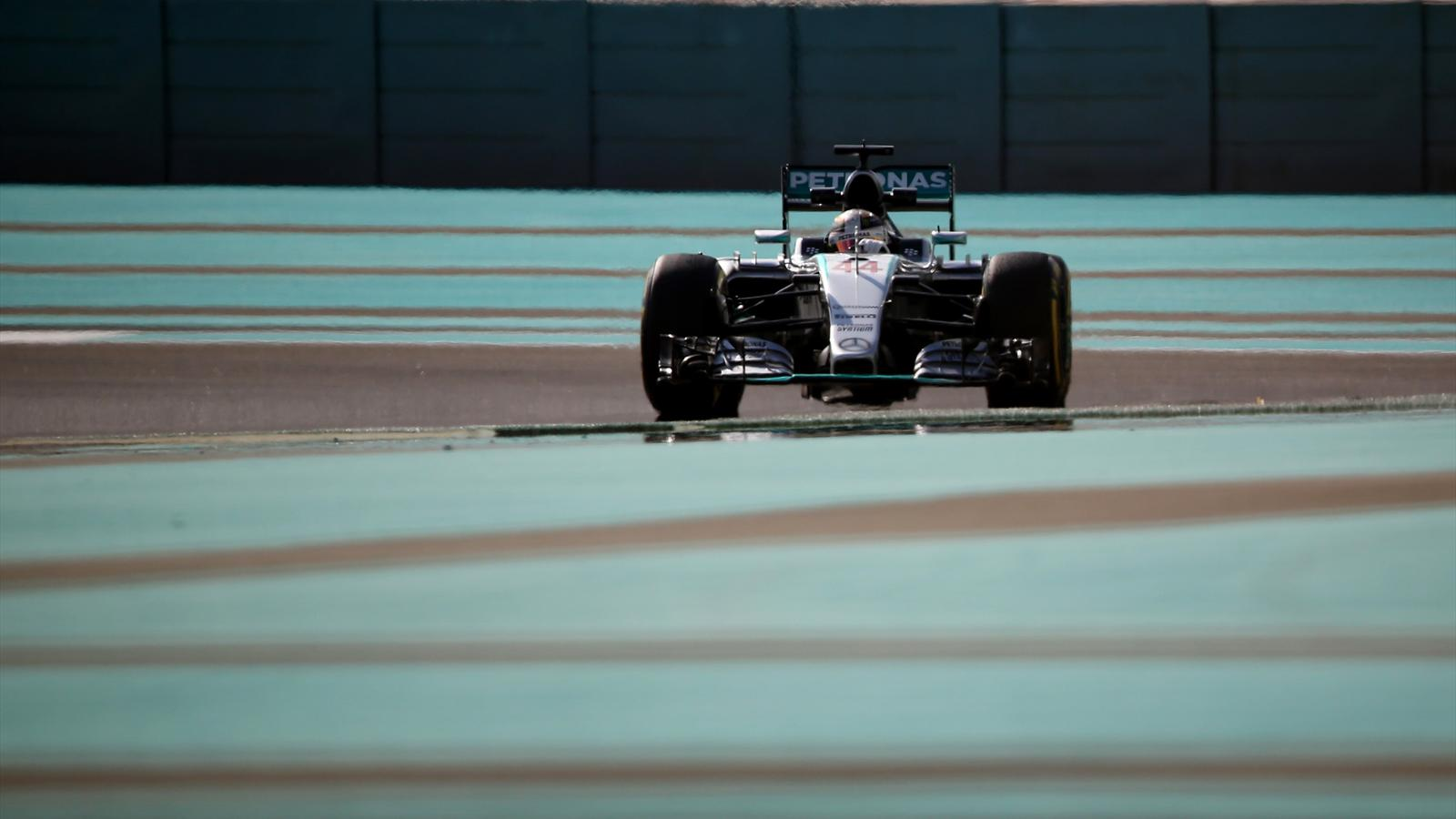 Mercedes AMG Petronas F1 Team's British driver Lewis Hamilton drives during the first practice session at the Yas Marina circuit in Abu Dhabi on November 27, 2015 ahead of the Abu Dhabi Formula One Grand Prix.