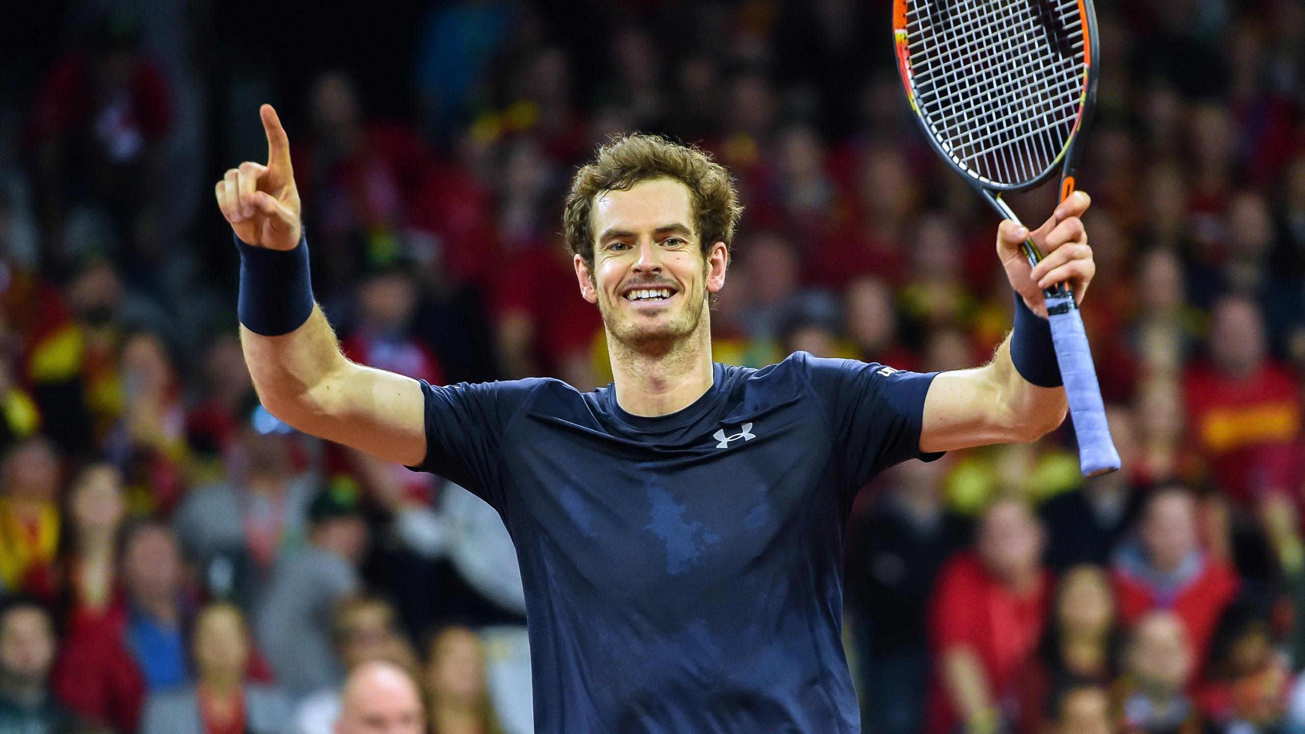 Britain's Andy Murray celebrates after the team won the doubles on the second day of the Davis Cup final against Belgium