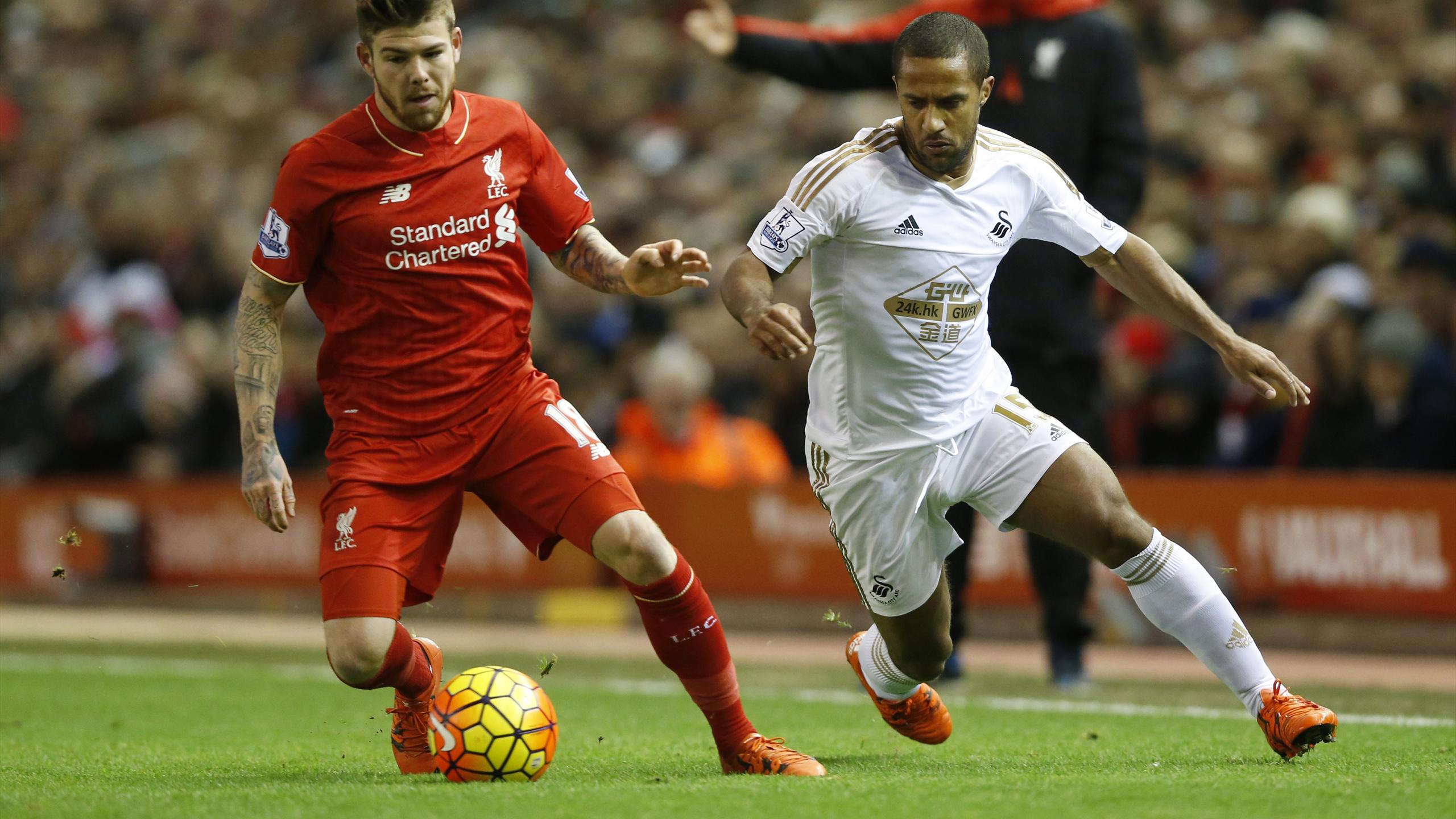 Alberto Moreno and Wayne Routledge tussle