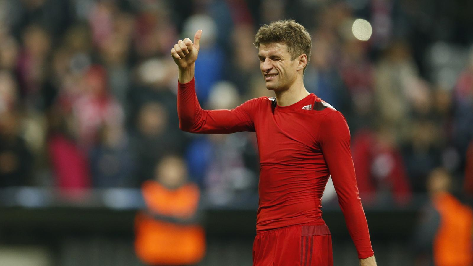 Bayern Munich's Thomas Muller celebrates at the end of the match
