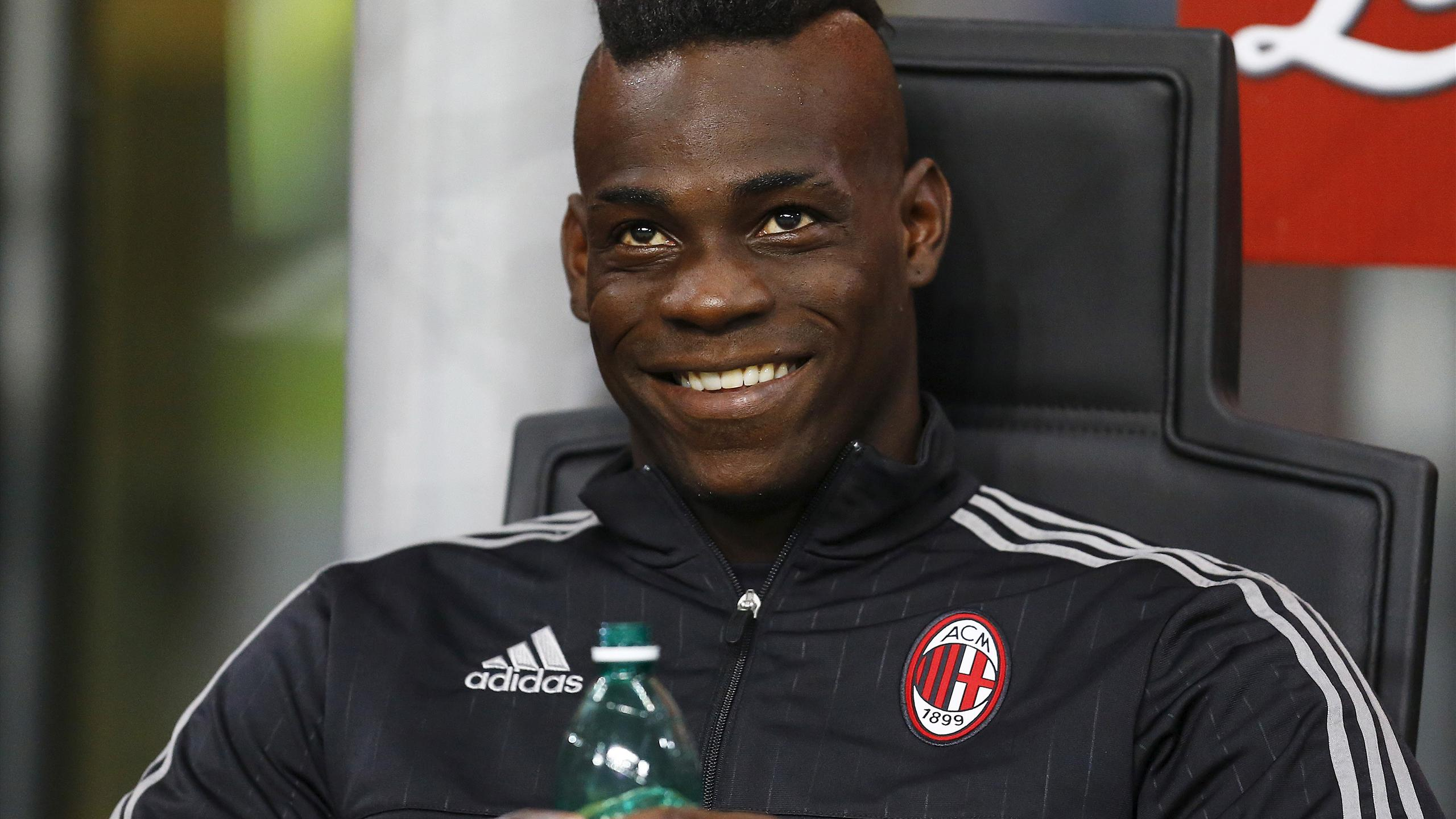 AC Milan's Mario Balotelli sits on the bench at the San Siro