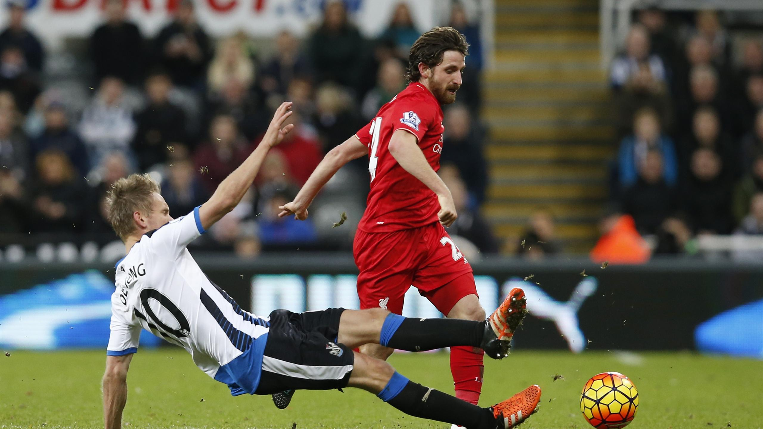 Liverpool's Joe Allen in action with Newcastle United's Siem de Jong