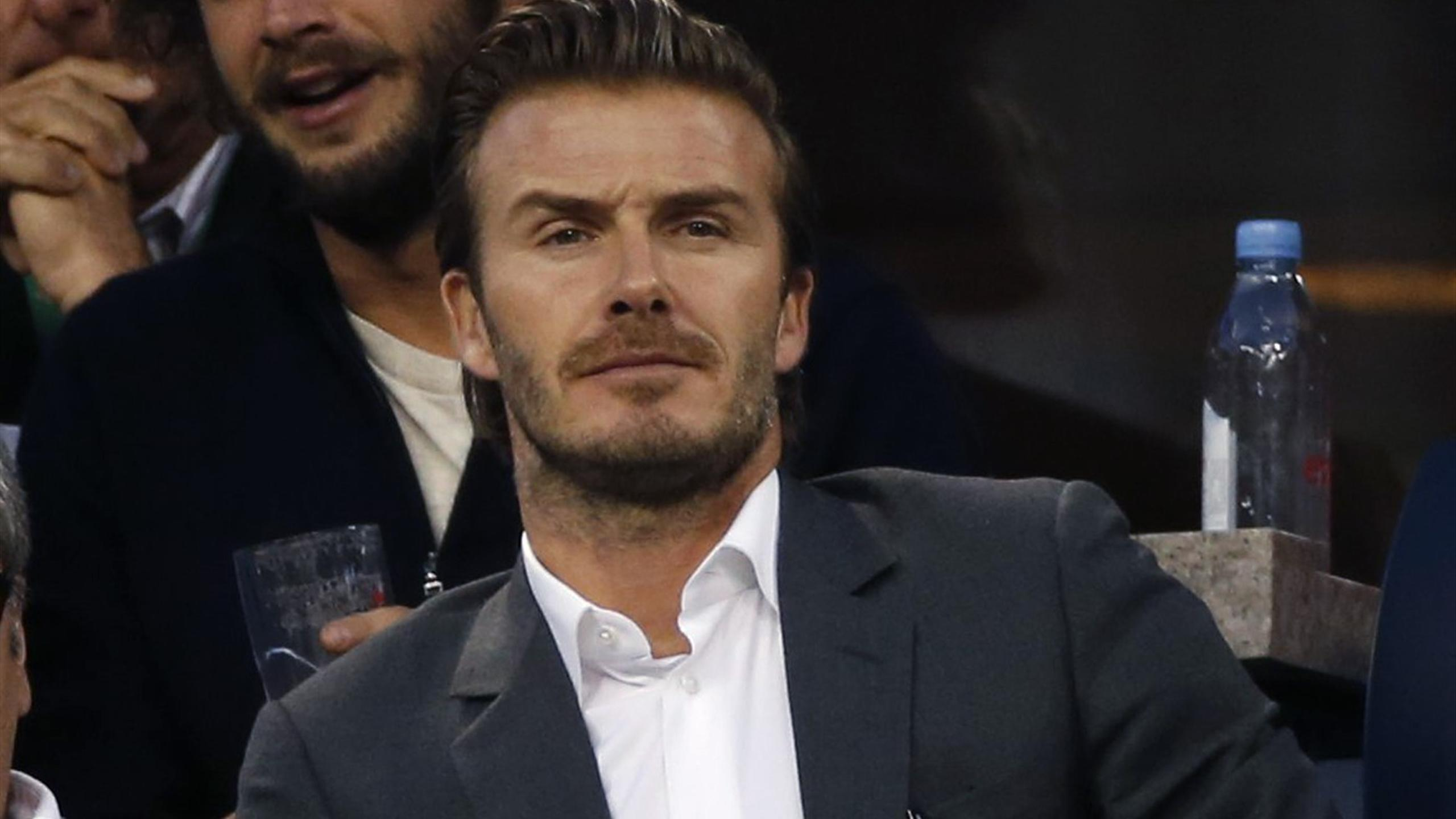David Beckham watches on from the stands