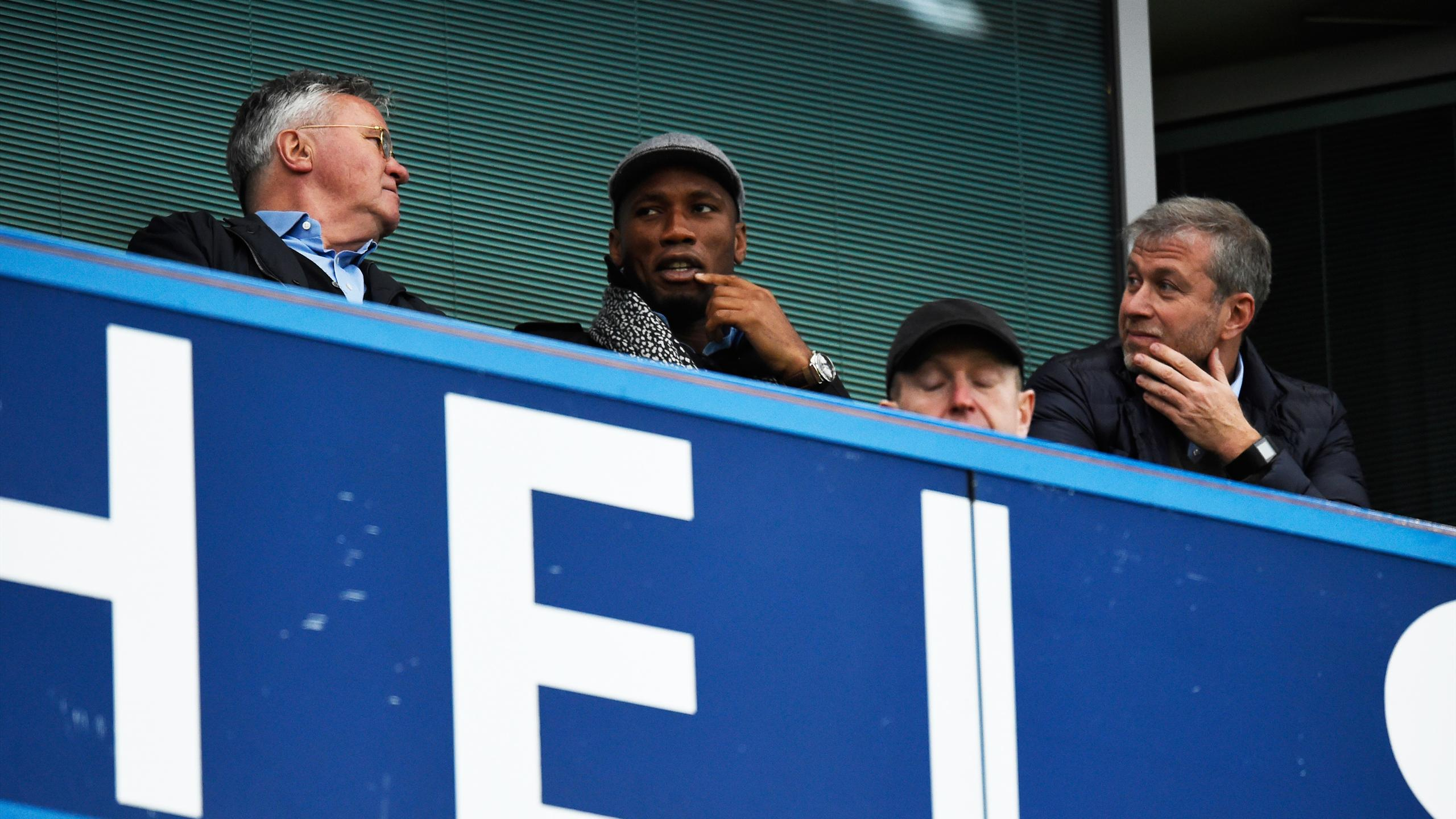 New Chelsea manager Guus Hiddink sat in the stands with Didier Drogba and owner Roman Abramovich before kick off