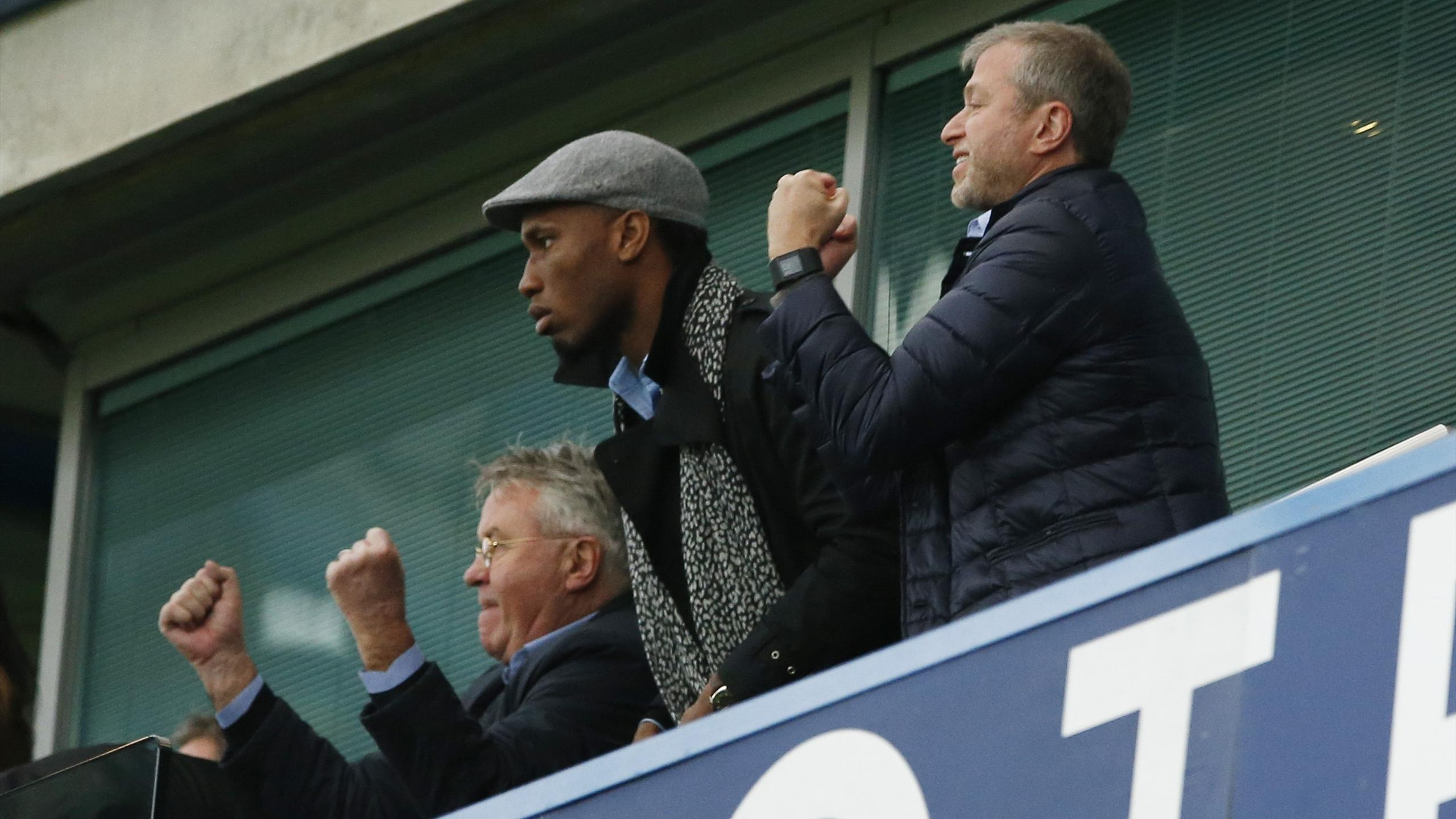 New Chelsea manager Guus Hiddink sat in the stands with Didier Drogba and owner Roman Abramovich