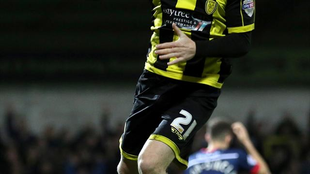 Burton stretch lead as Wigan held by Colchester