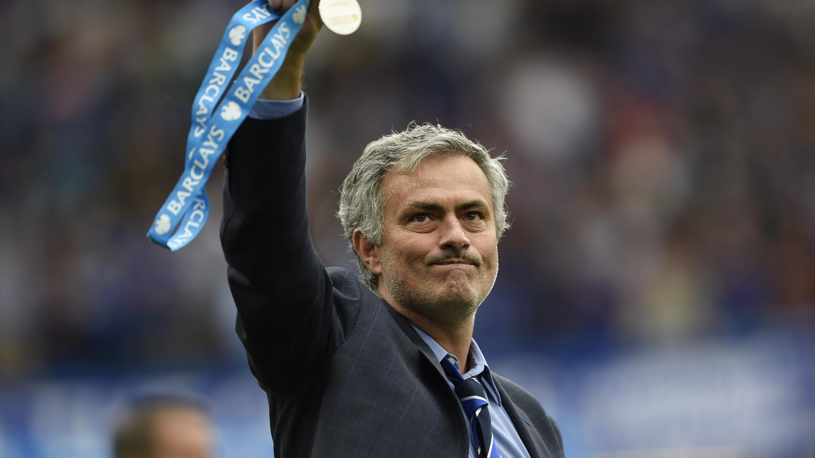 Jose Mourinho celebrates with his medal after winning the Premier League