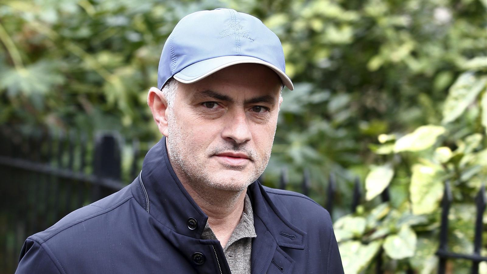 Former Chelsea manager Jose Mourinho walks near to his home in London