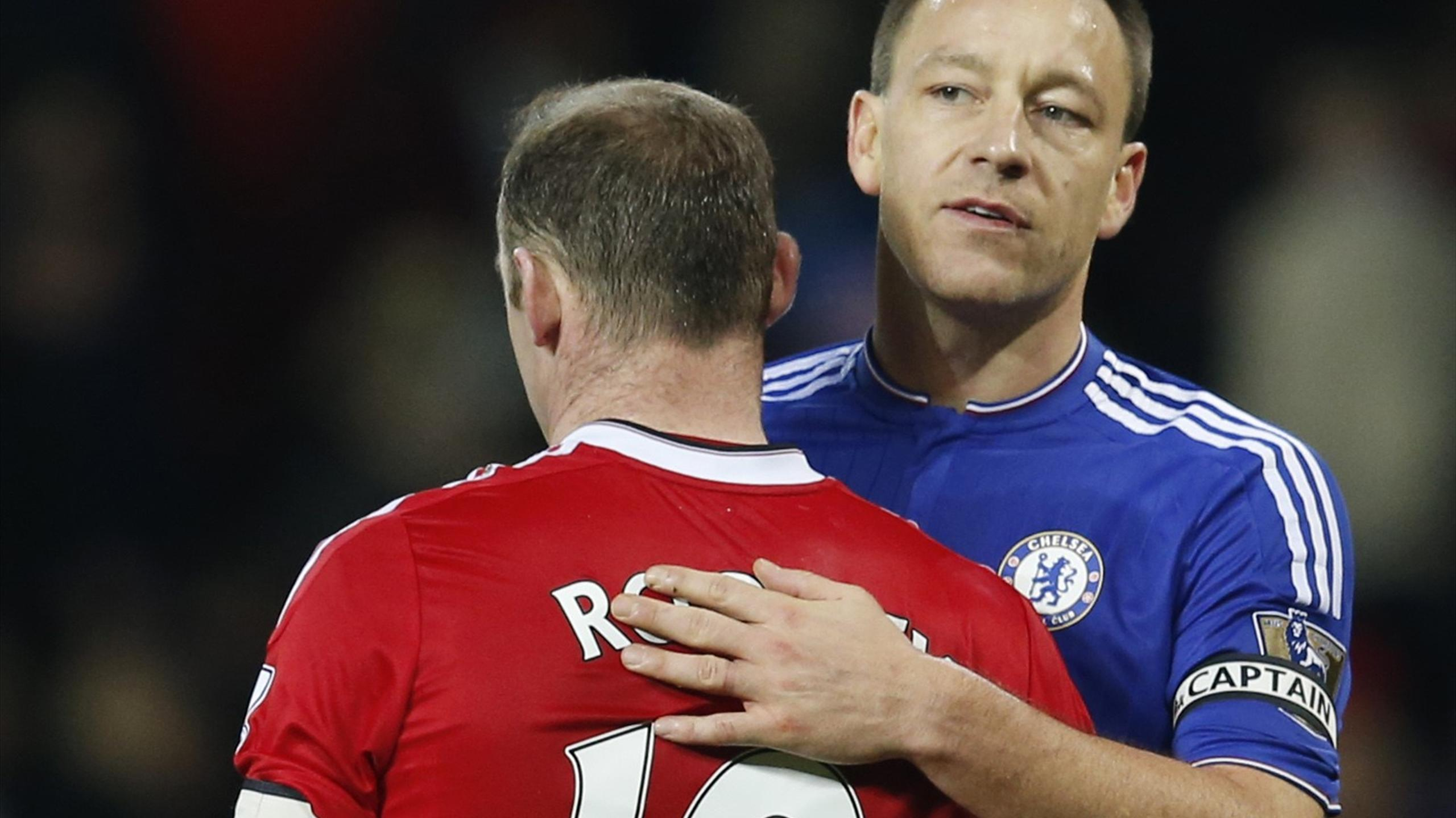 Manchester United's Wayne Rooney with Chelsea's John Terry at full time