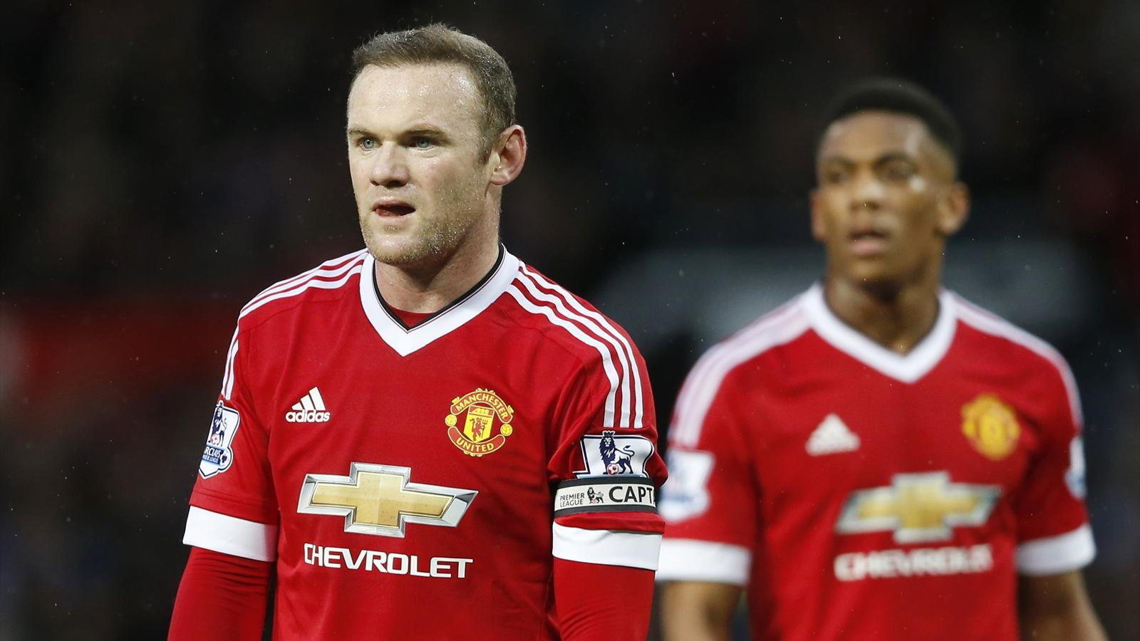 Manchester United's Wayne Rooney and Anthony Martial against Swansea