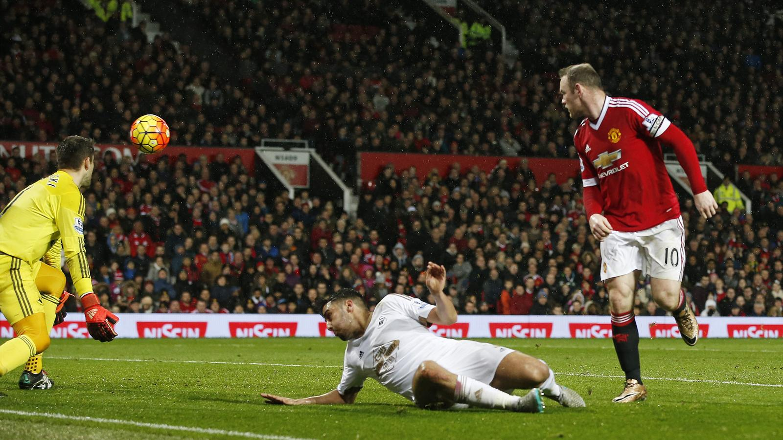 Manchester United's Wayne Rooney flicks the ball into the Swansea net