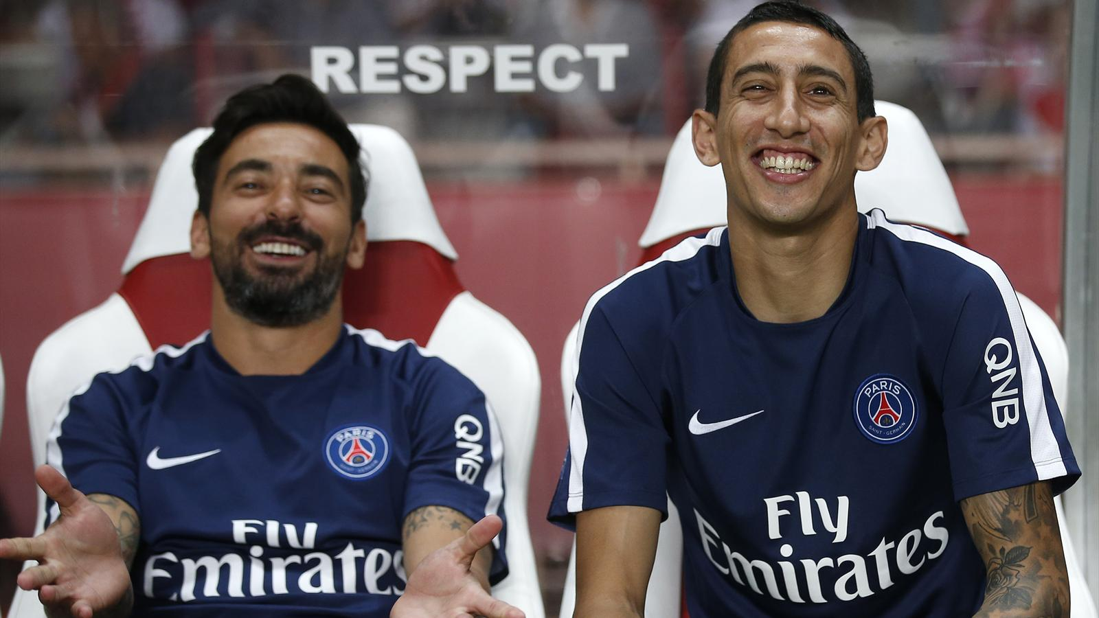 Paris St Germain's Angel Di Maria (R) and Ezequiel Lavezzi sit on the Paris Saint-Germain bench