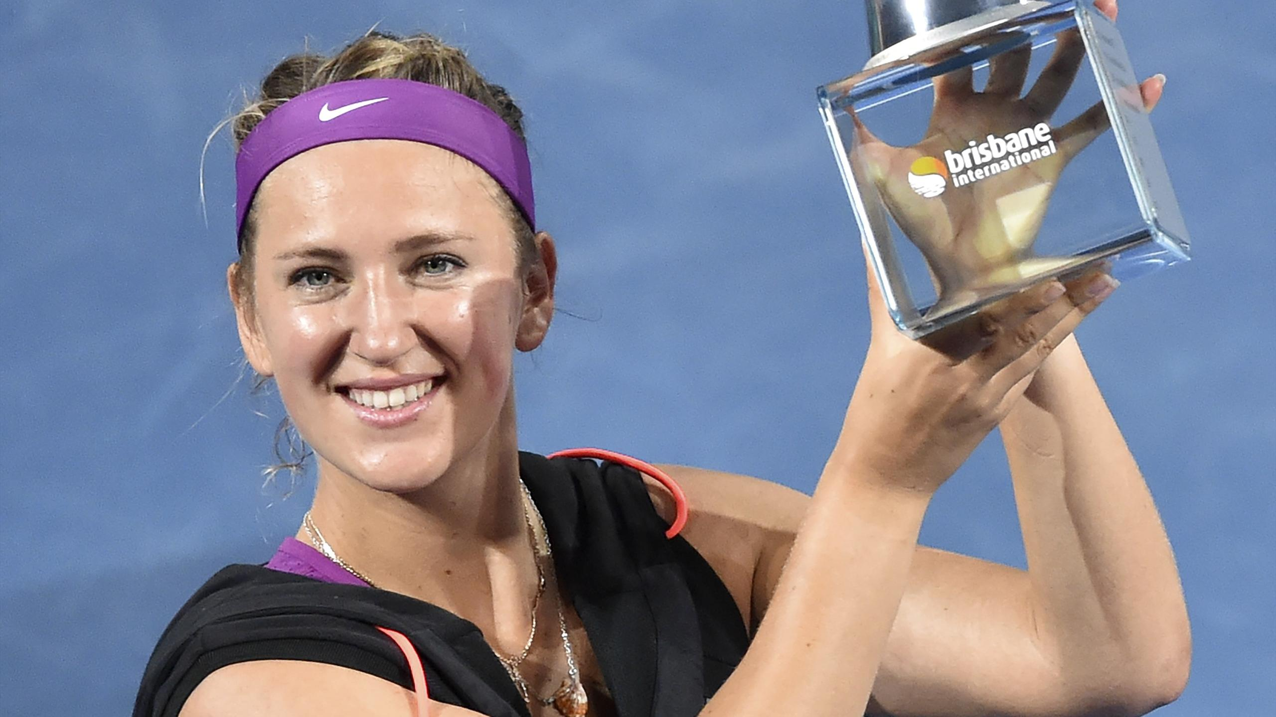 Victoria Azarenka of Belarus lifts her winning trophy after defeating Angelique Kerber of Germany in the women's final of the Brisbane International tennis tournament