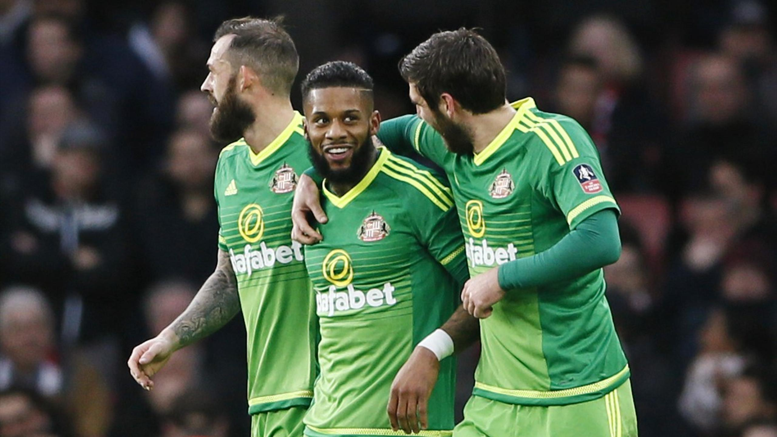 Jeremain Lens celebrates with Danny Graham and Steven Fletcher after scoring the first goal for Sunderland against Arsenal