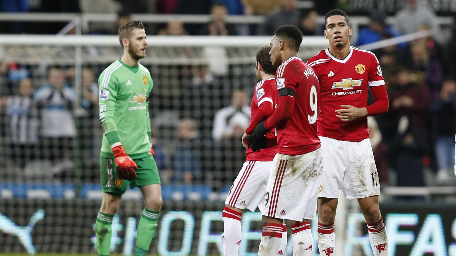 Manchester United's Chris Smalling, Anthony Martial, Juan Mata and David De Gea look dejected at the end of the match