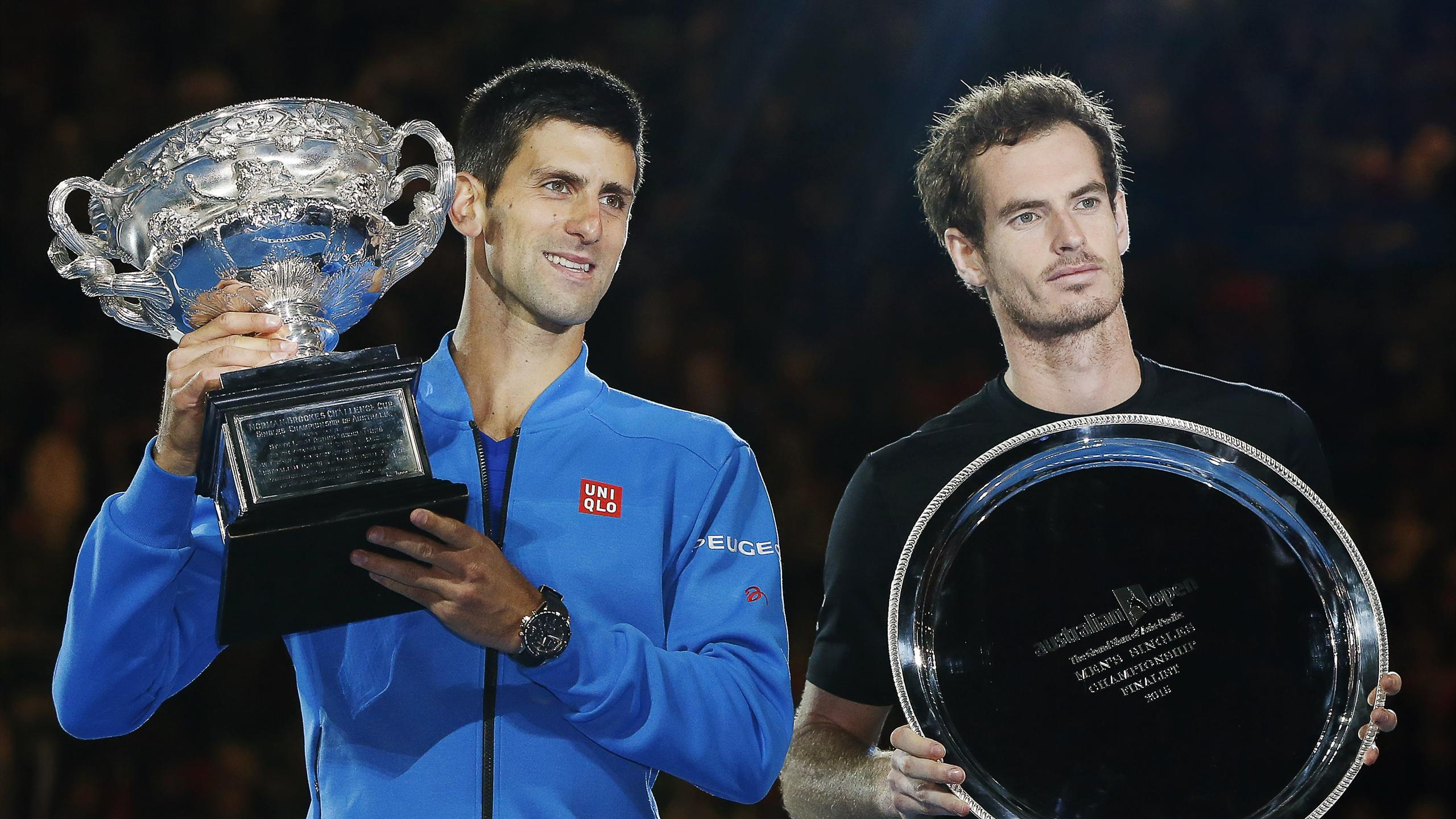 Novak Djokovic (L) of Serbia holds up his trophy next to runner-up Andy Murray of Britain after winning their men's singles final match at the 2015 Australian Open in Melbourne