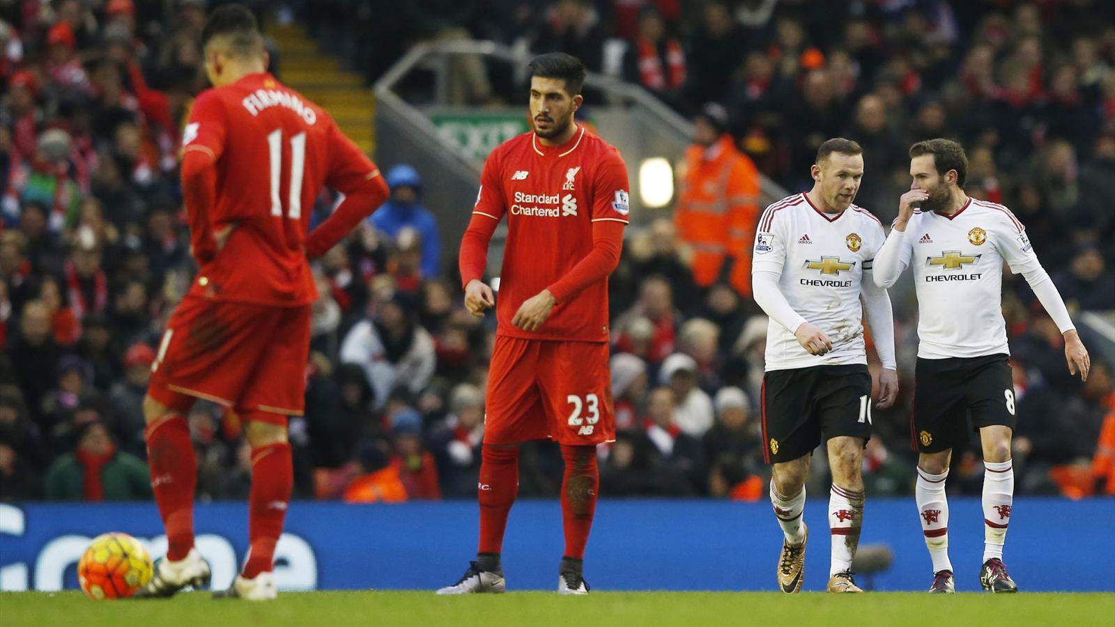 Liverpool's Emre Can and Roberto Firmino look dejected after Wayne Rooney (2nd R) scored the first goal for Manchester United