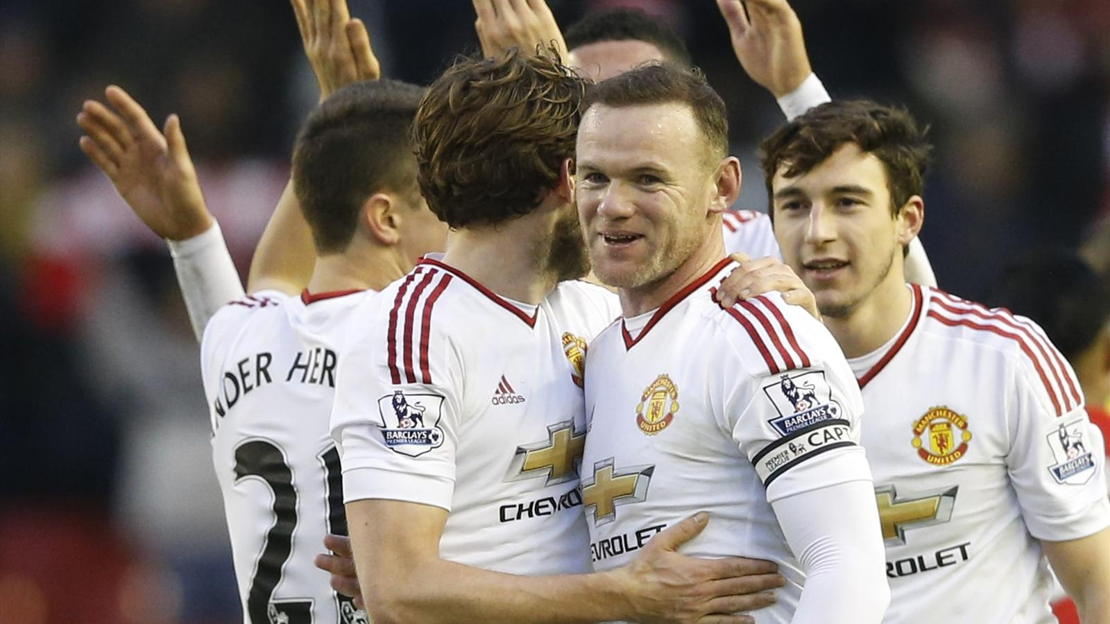 Manchester United's Wayne Rooney celebrates at full time with teammates