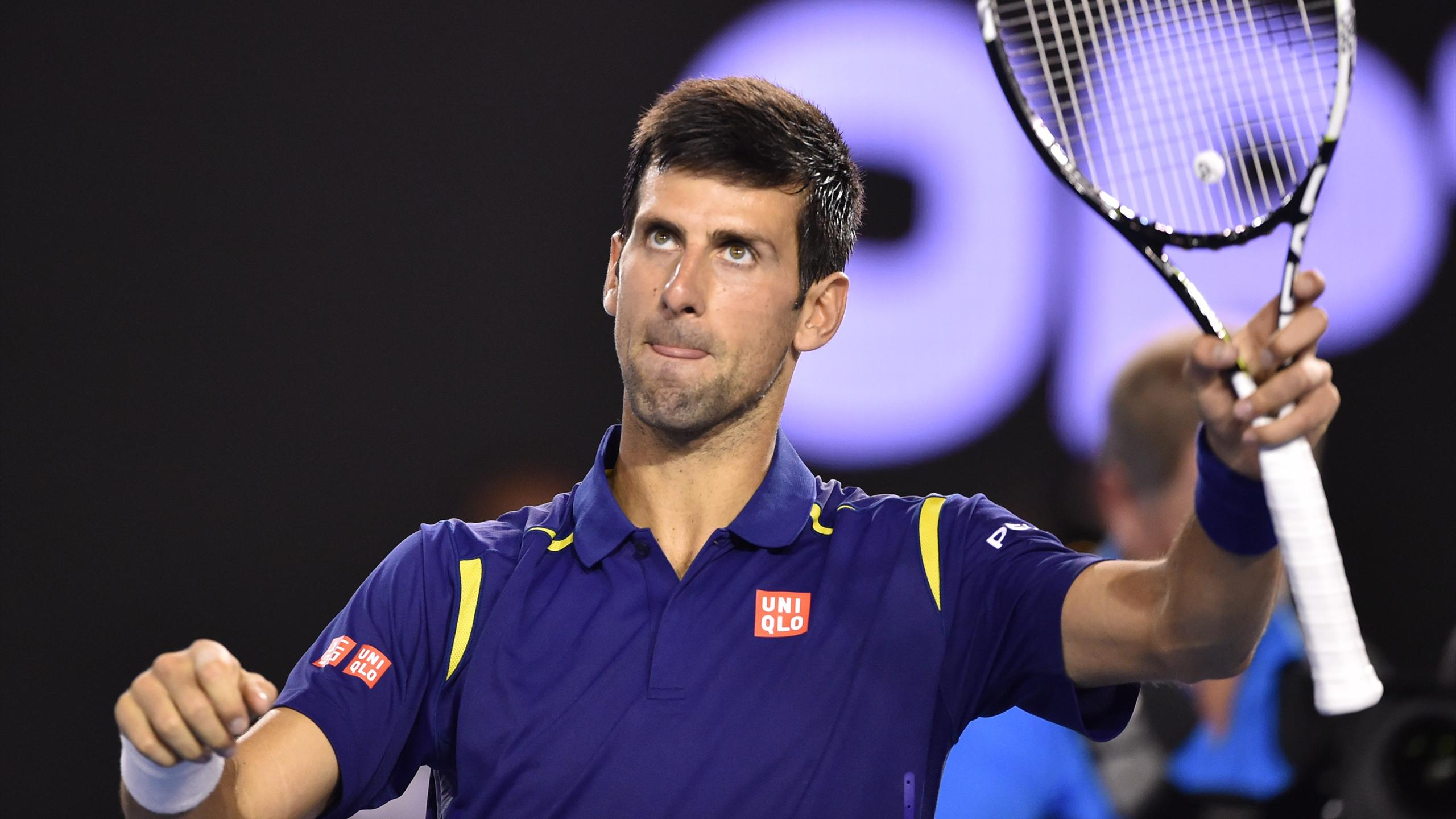Serbia's Novak Djokovic celebrates after victory in men's singles match against France's Quentin Halys