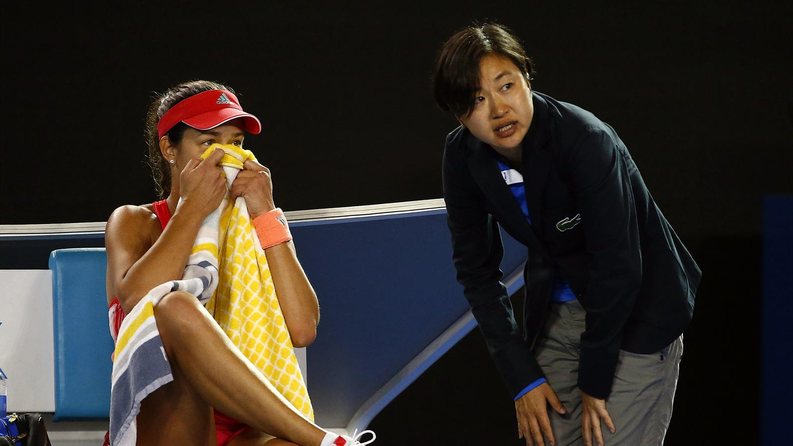Serbia's Ana Ivanovic reacts as she talks to an official after a fall during her second round match against Latvia's Anastasija Sevastova