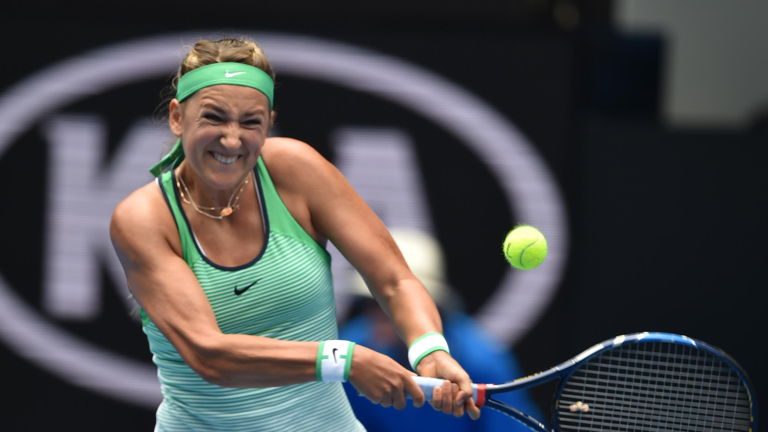 Belarus's Victoria Azarenka plays a backhand return during her women's singles match against Montenegro's Danka Kovinic on day four of the 2016 Australian Open tennis tournament in Melbourne on January 21, 2016.