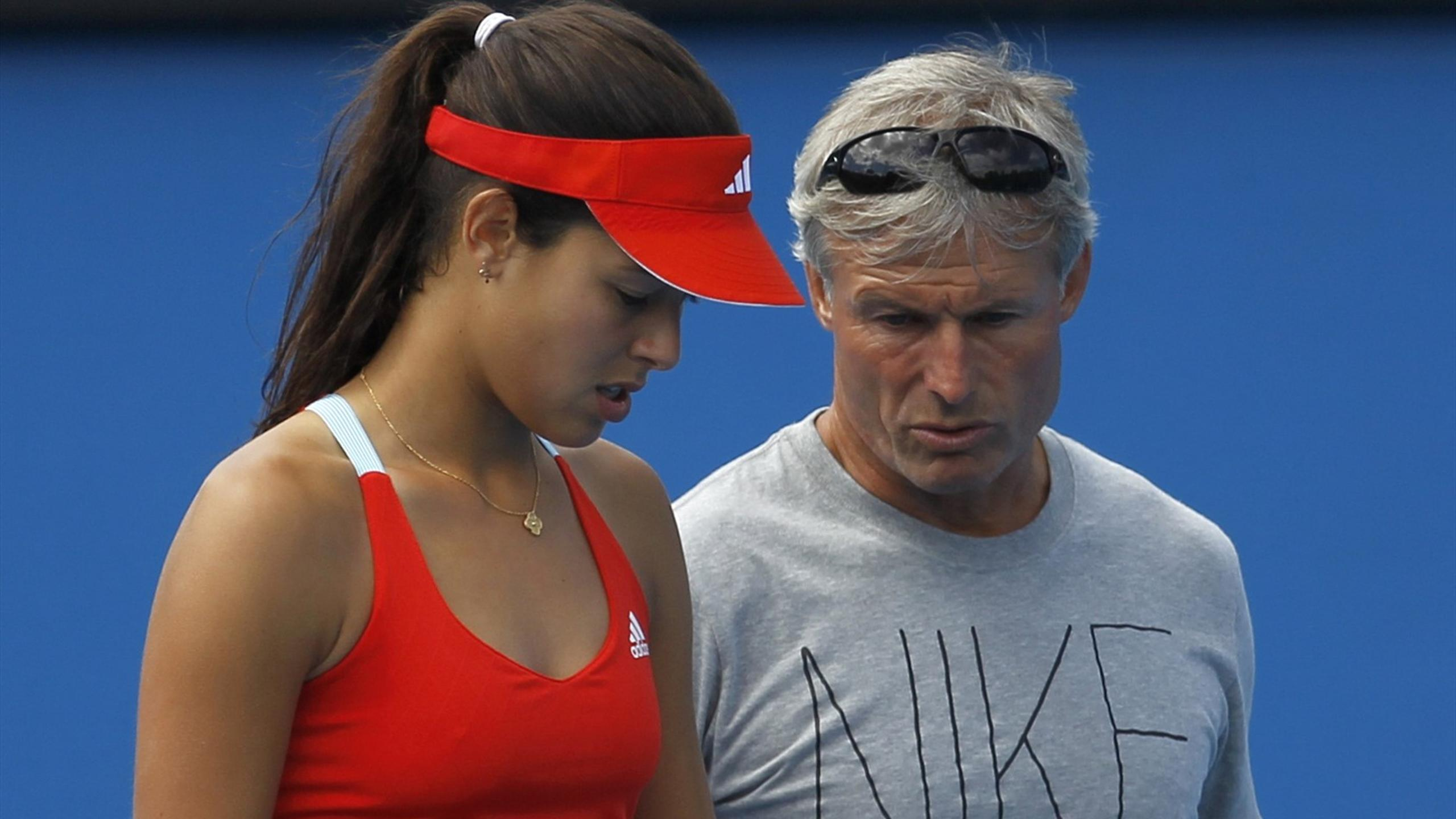 Ana Ivanovic of Serbia talks to coach Nigel Sears during a practice session