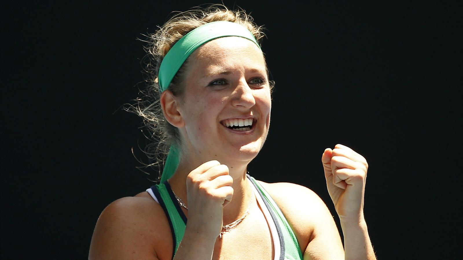 Belarus' Victoria Azarenka celebrates after winning her fourth round match against Czech Republic's Barbora Strycova at the Australian Open