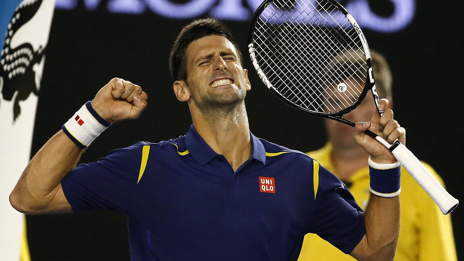 Serbia's Novak Djokovic celebrates after winning his semi-final match against Switzerland's Roger Federer at the Australian Open