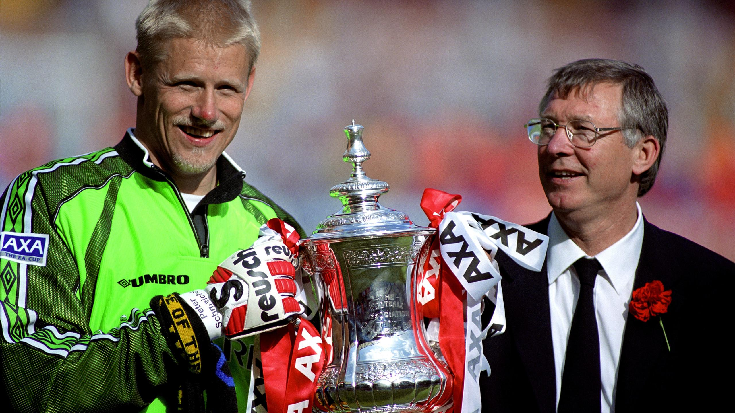 Manchester United's Peter Schmeichel & Manager Alex Ferguson hold the FA Cup trophy