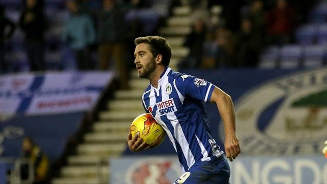 Wigan turn up heat as top two Burton and Gillingham suffer defeats