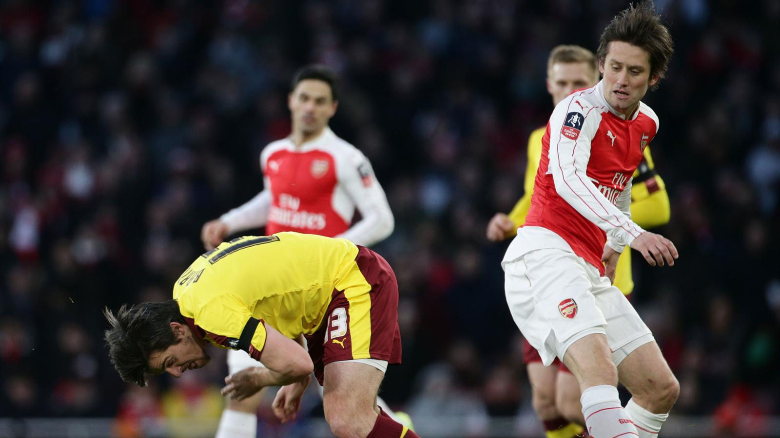 Burnley's Joey Barton (left) and Arsenal's Tomas Rosicky battle for the ball